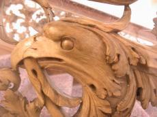 scultpure statue egale bird head beak brown wood wooden carve carved