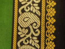 weave silk batik wove fabric clothe pattern texture green yellow black