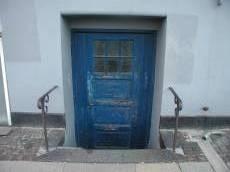 tabus door blue wood railings stairs