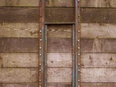 wooden panel planks brown metal strips bolts