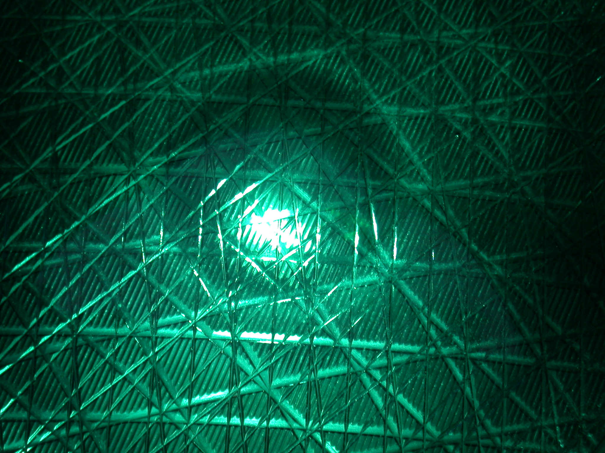 green traffic light up close green plastic