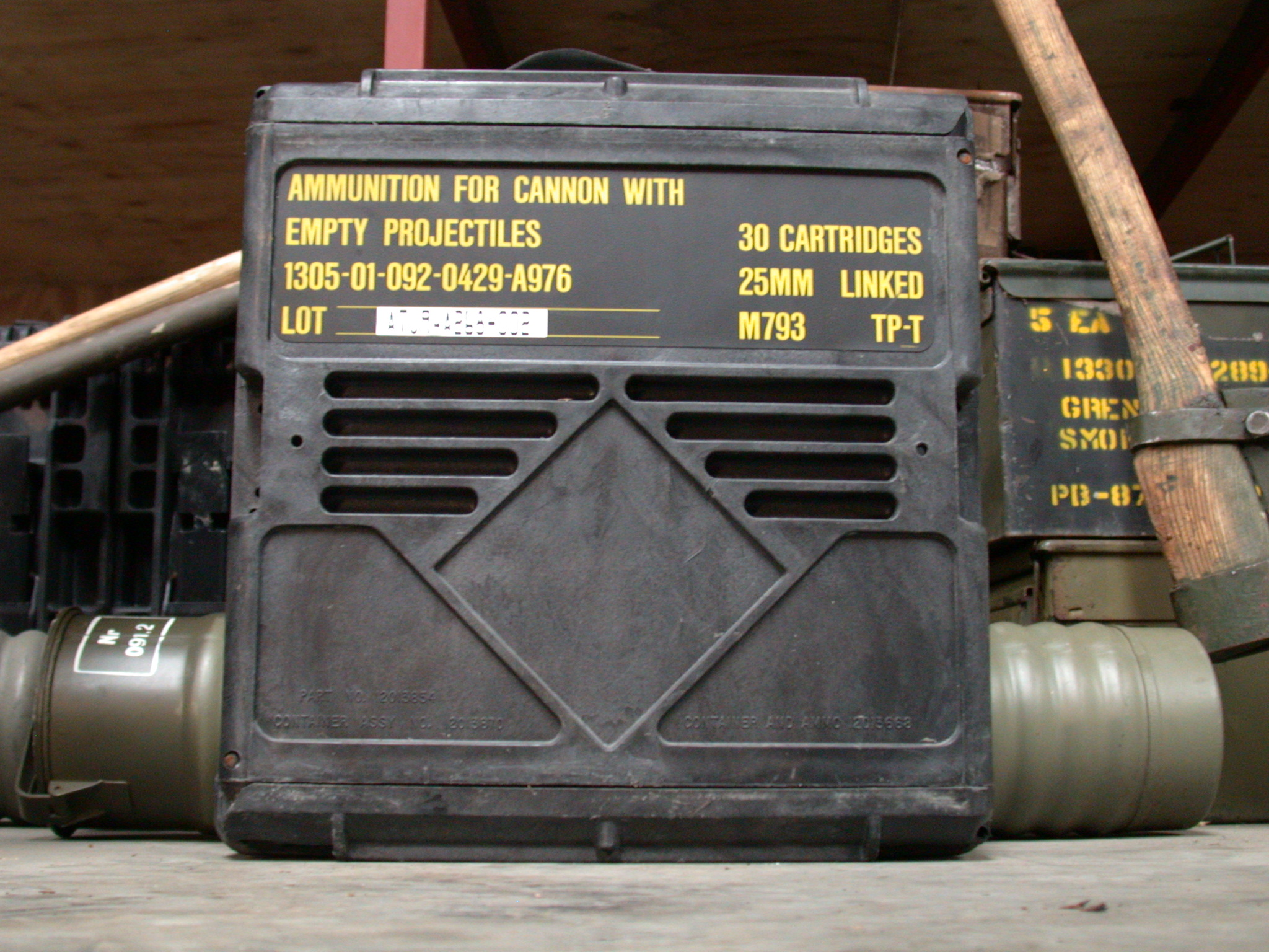 ammunition crate for cannon with empty projectiles black plastic yellow letters royalty-free