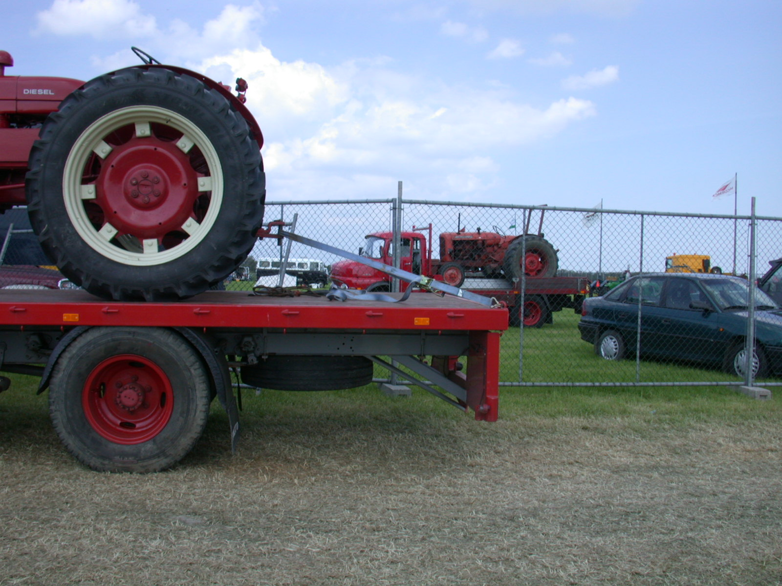 tire tires tracktor loading round huge big wheel wheels truck cars red