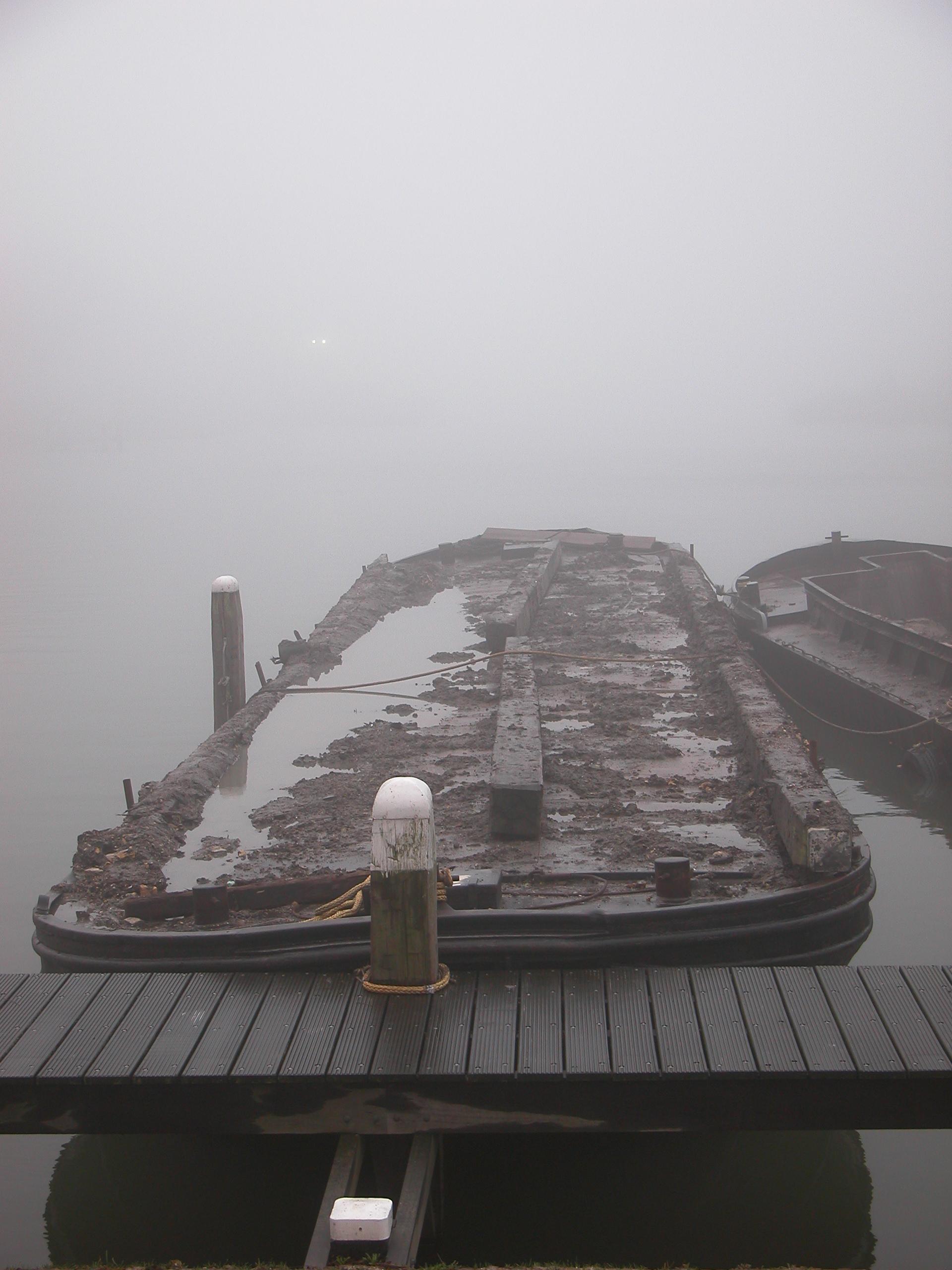 vehicles water warf quay barge mist fog royalty-free