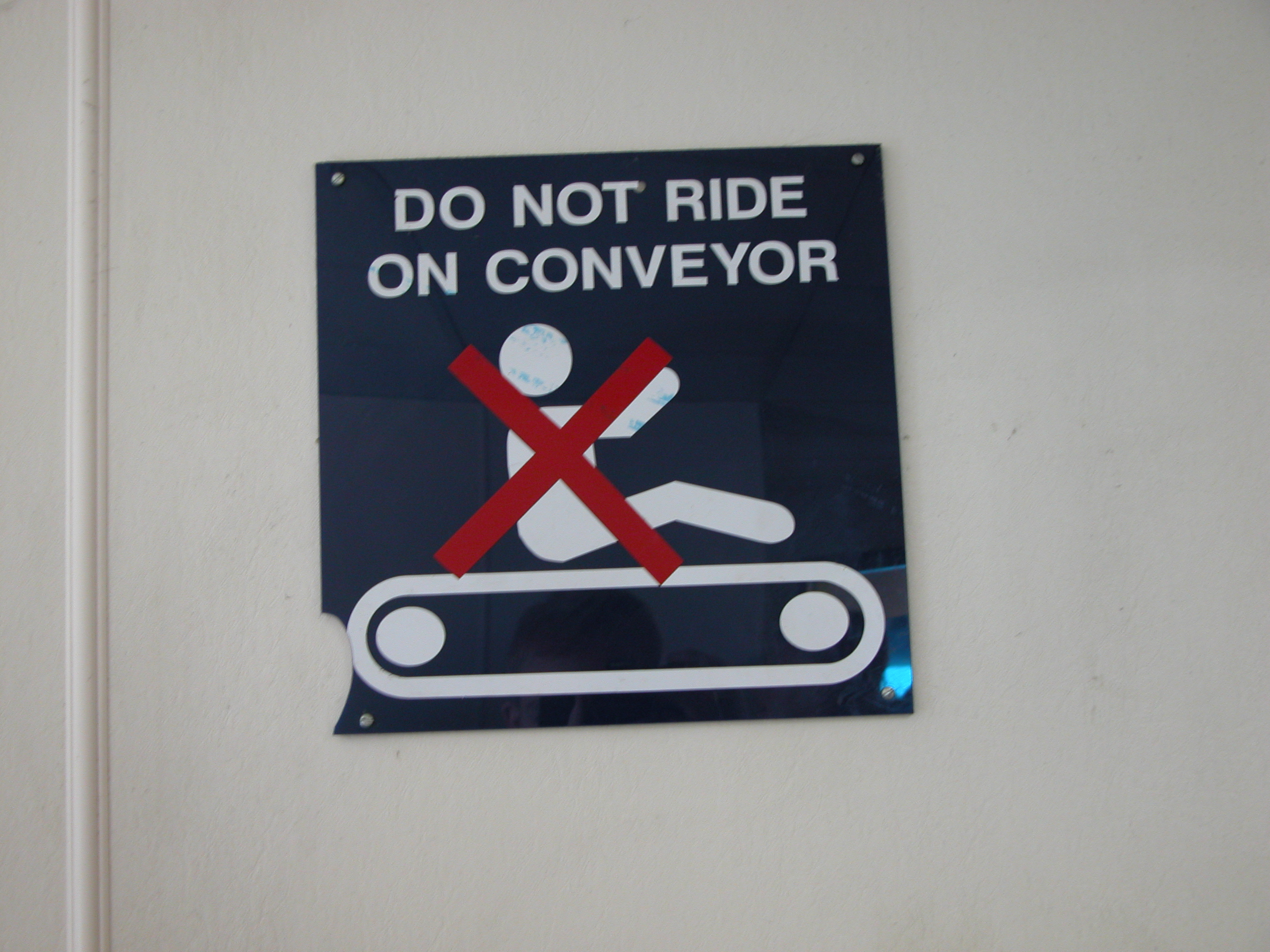 do not ride on conveyor sign