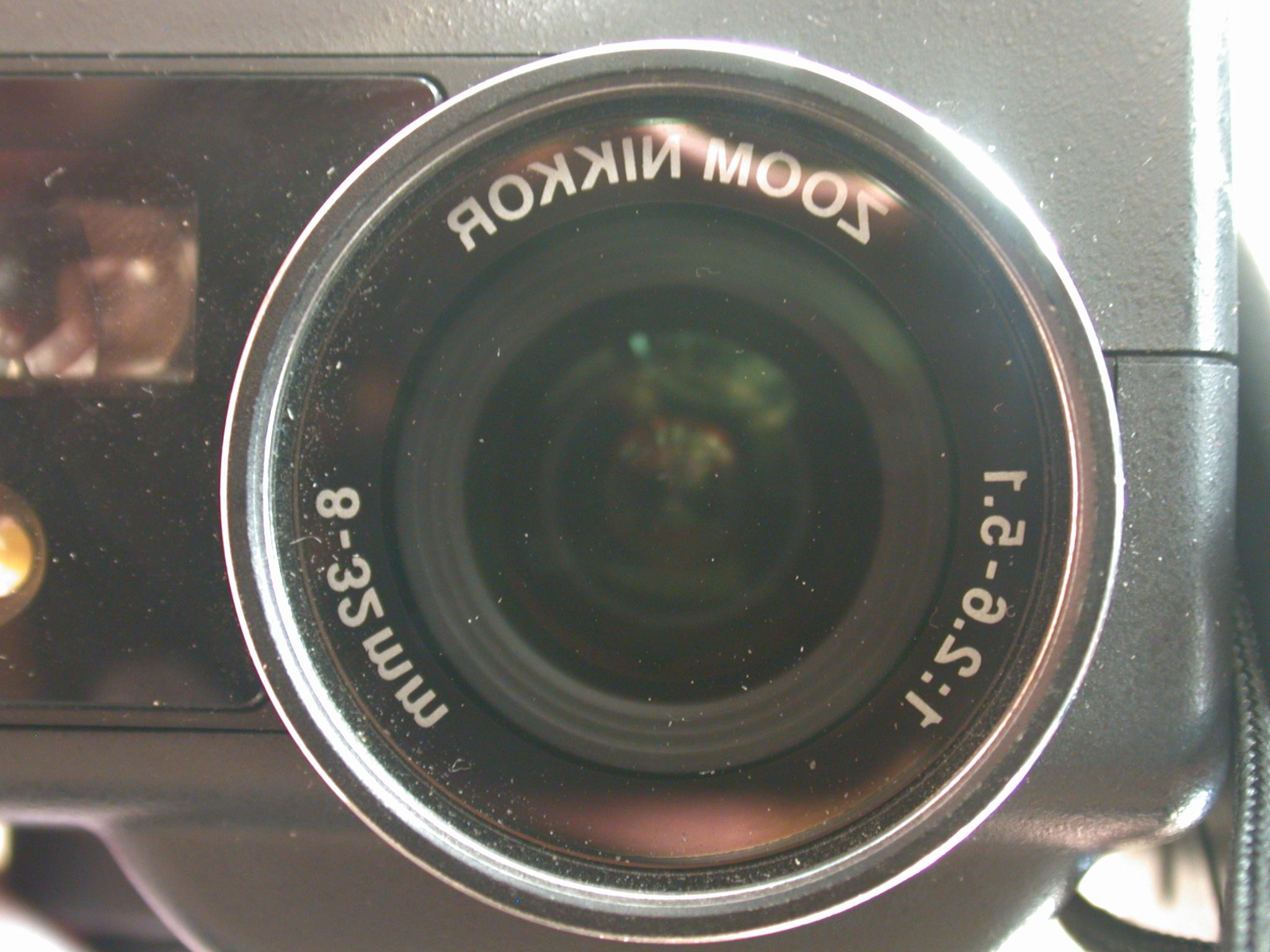 nikkon nikkor old camera zoom lens optic optical round shiny glossy mm 35-8 8 35 milimeter flash