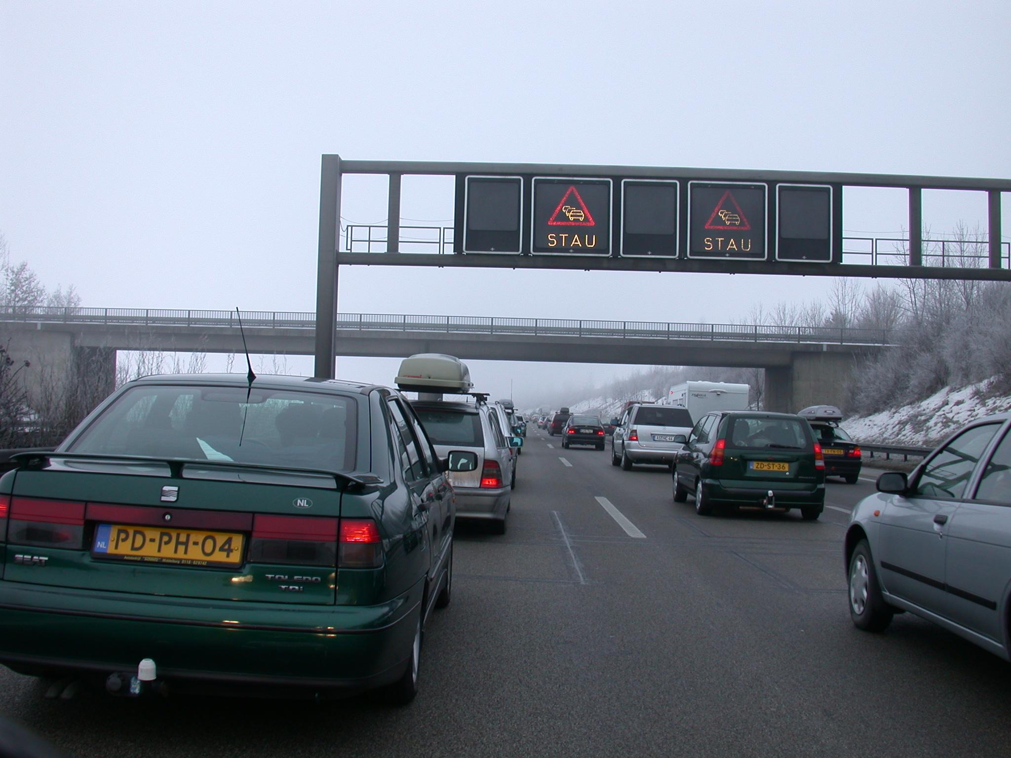 vehicles land trafficjam jam traffic car cars road roadsigns signs stay bridge light typography sanserif objects