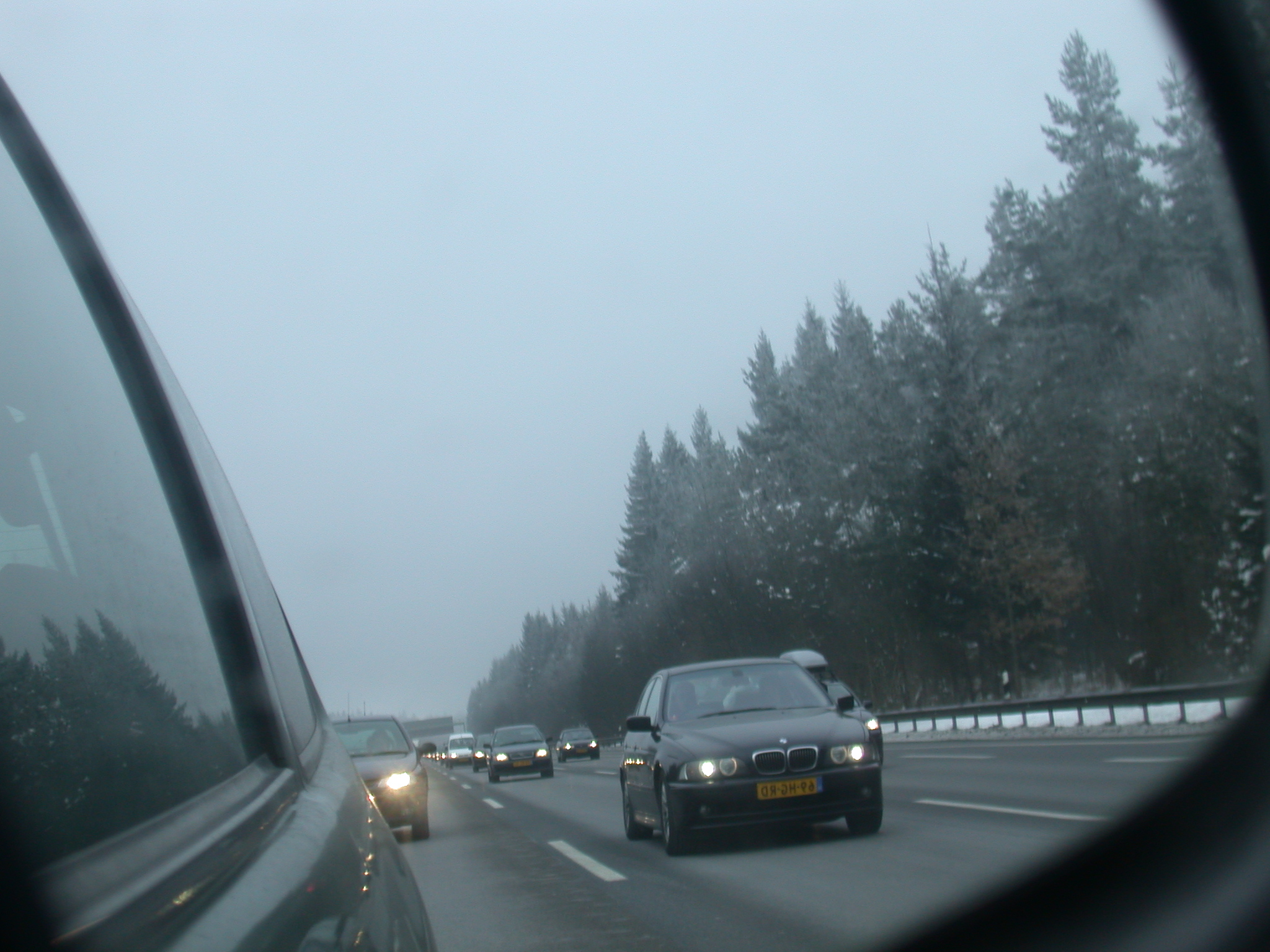 car rearview rear-view rear view mirror highway autobahn cars speed snow winter