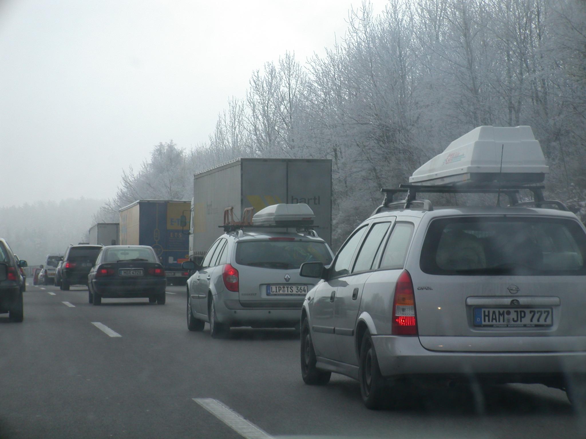 german car cars licence licenceplate plate number numberplate traffic peak peaktime file congestion autobahn packed tight road freeway motorway highway