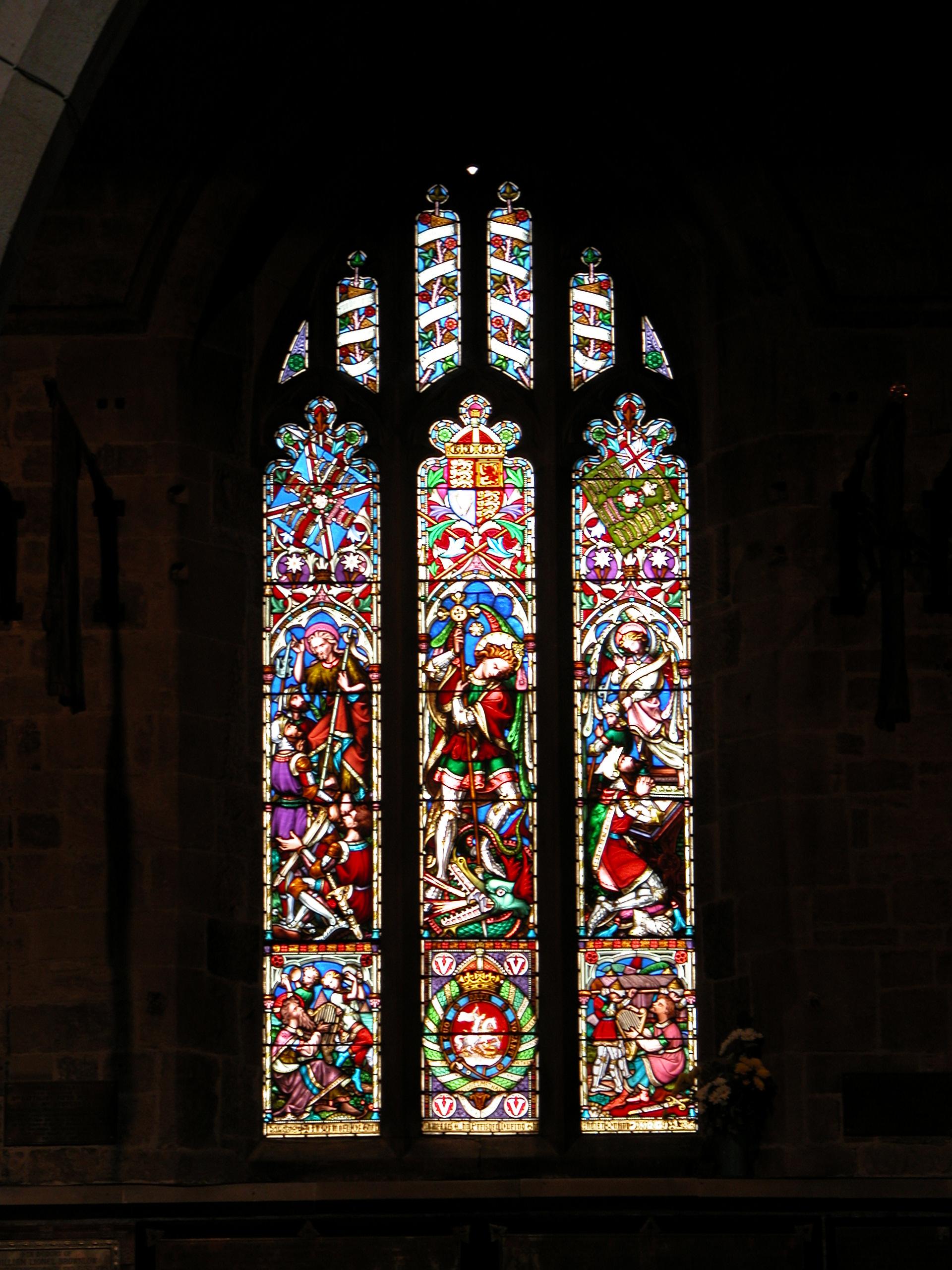 glass in lead church window bright colours arc