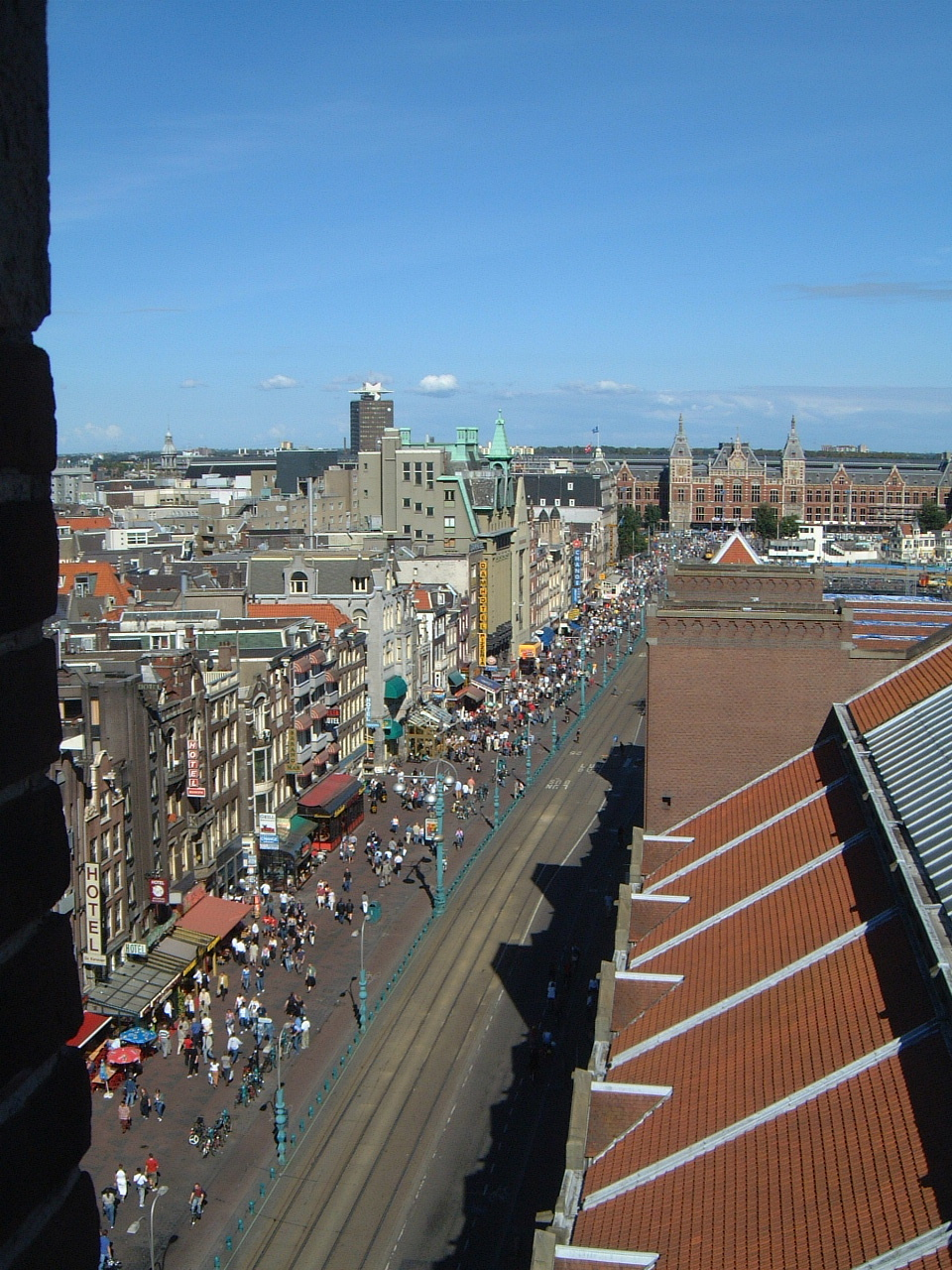maartent amsterdam cityscape station summer shell city buildings roofs crowd people