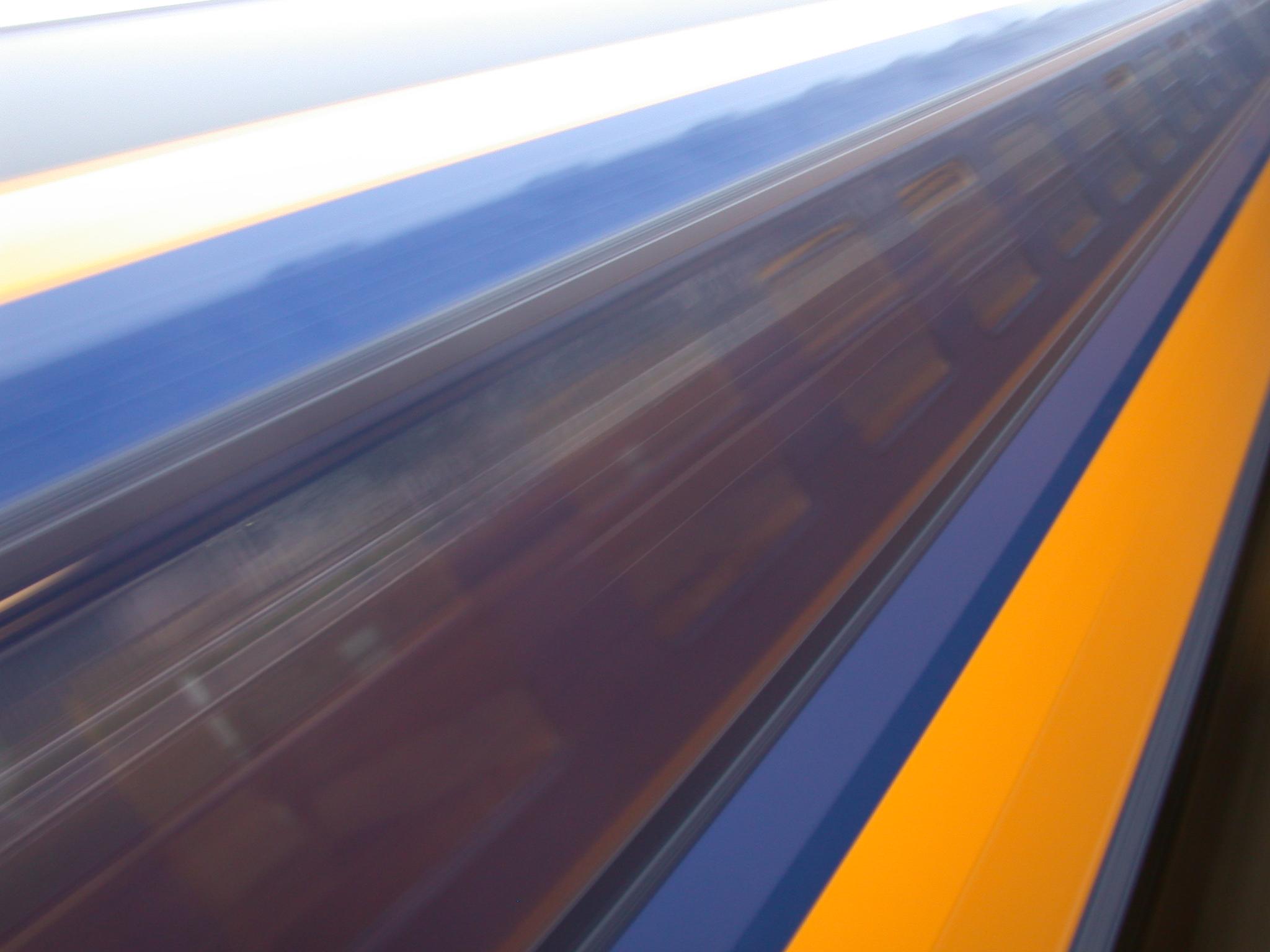 train traffic speed blur blurs blue yellow diagonal dutch vehicles land