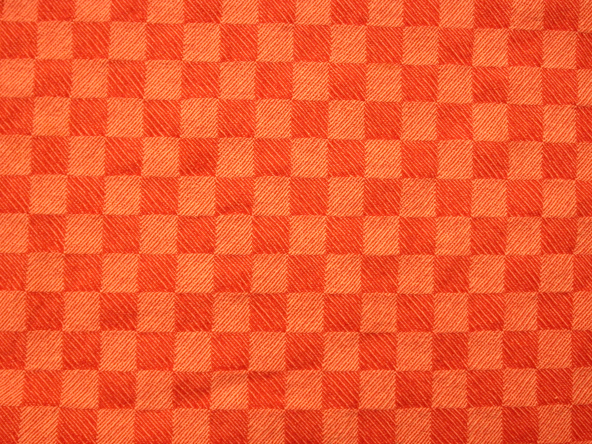 red orange tablecloth square blocks checker pattern