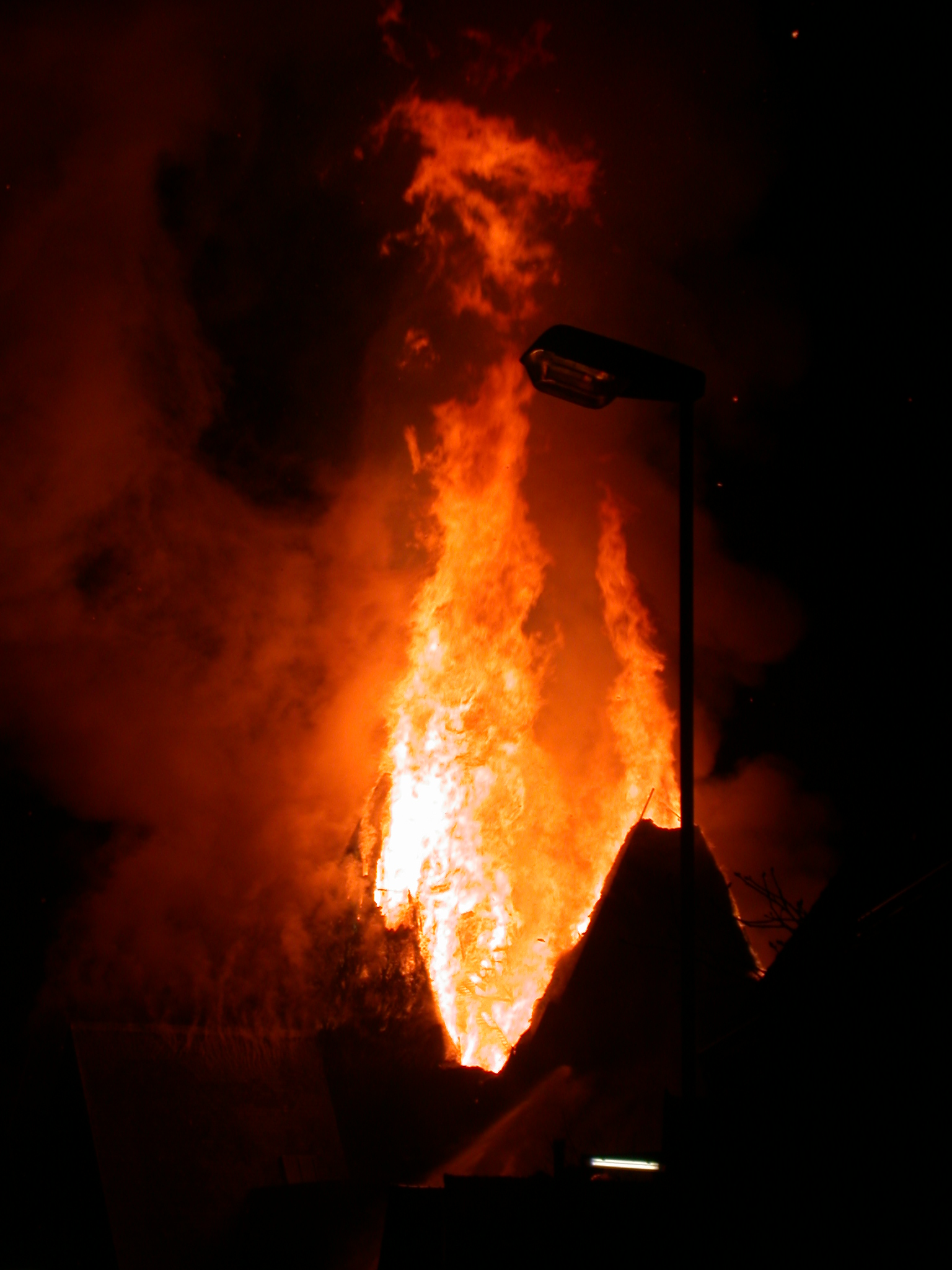 burn burning flame flames bonfire house going up in night sky dark roaring fire tongues of