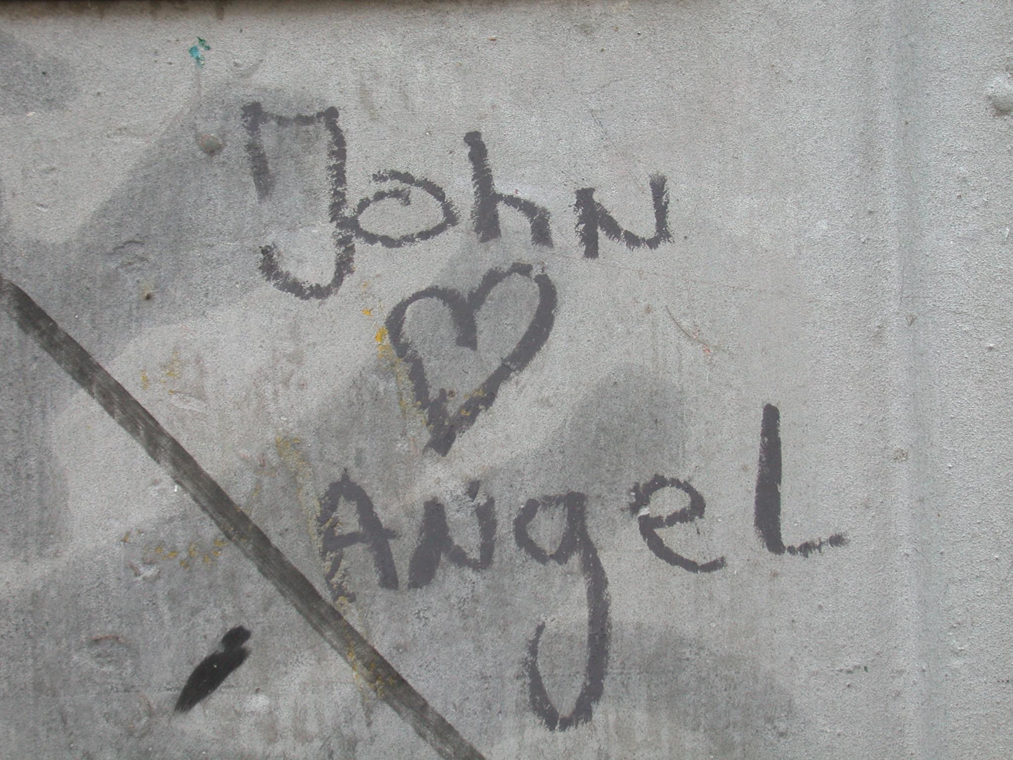 john loves angel graffiti spray paint wall hearth script text