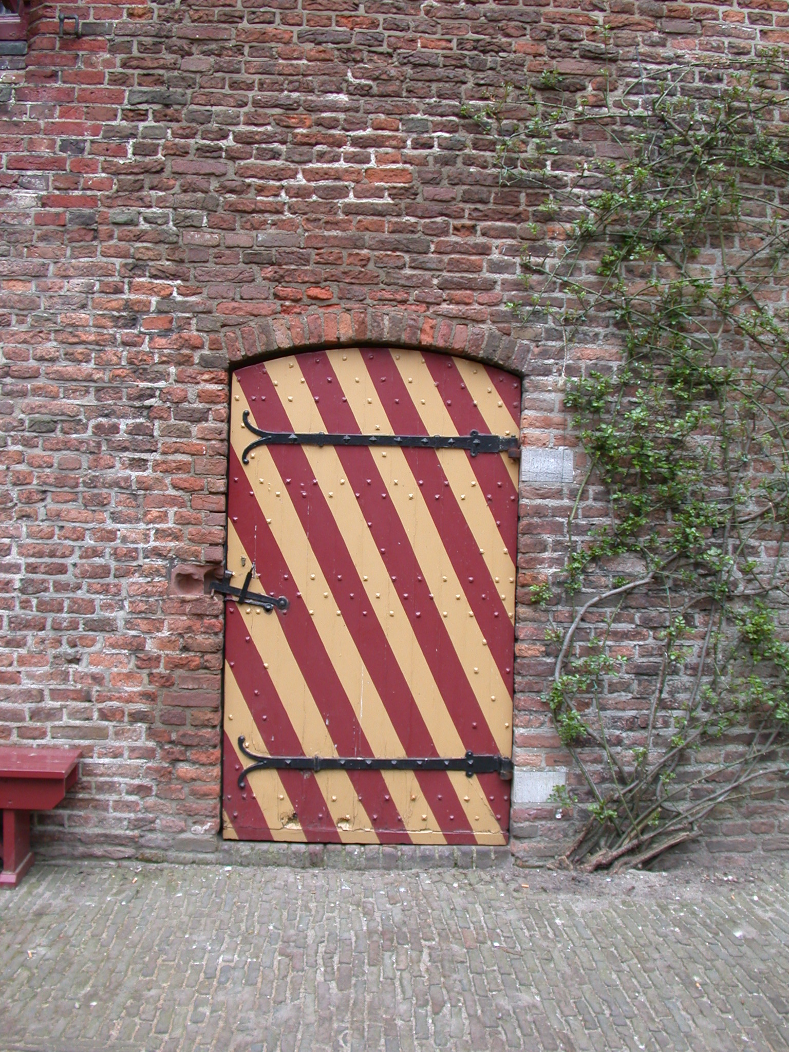 brick wall striped stripes door round top yellow red