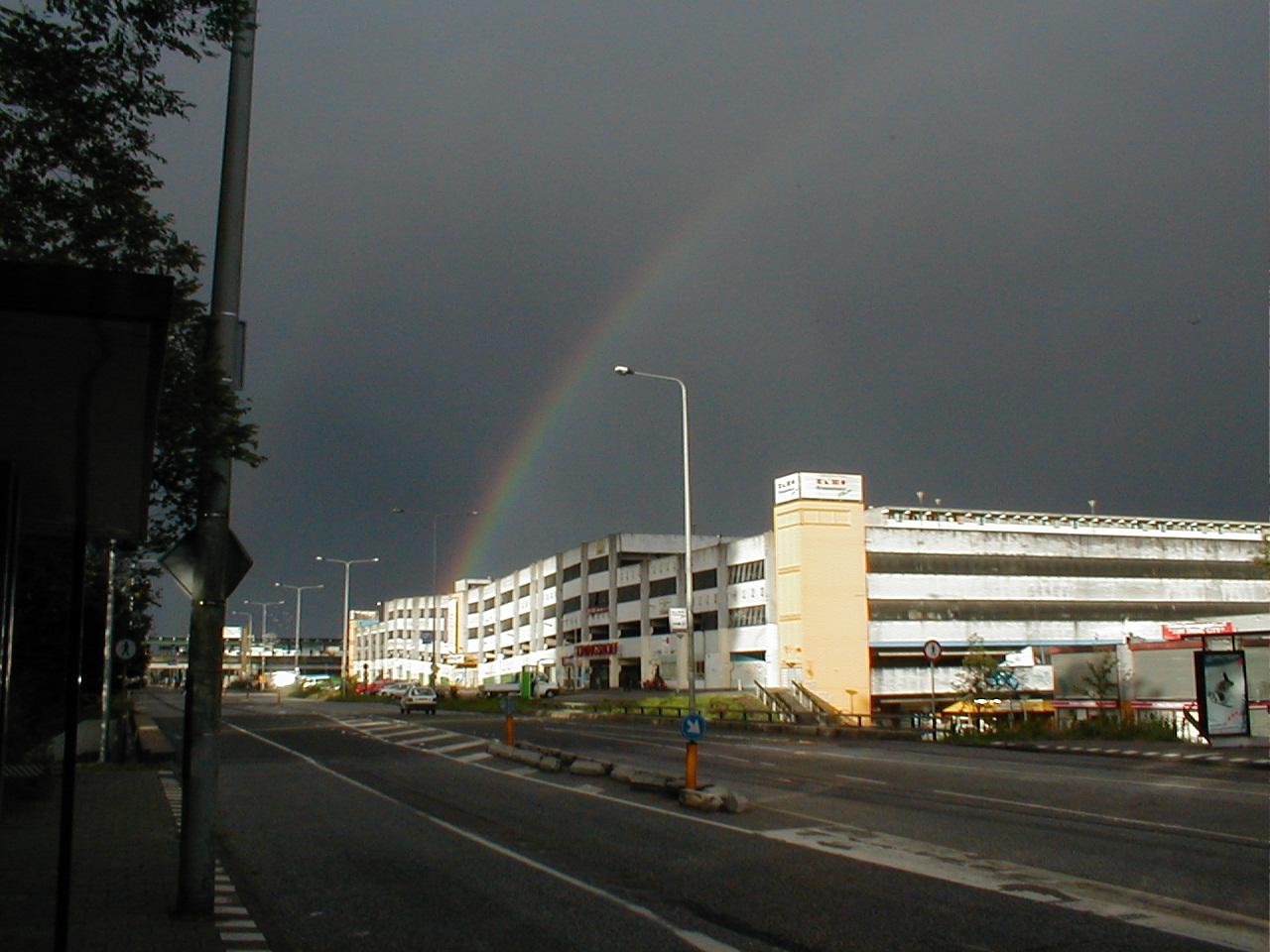 dario rainbow dark sky bad weather highway road building
