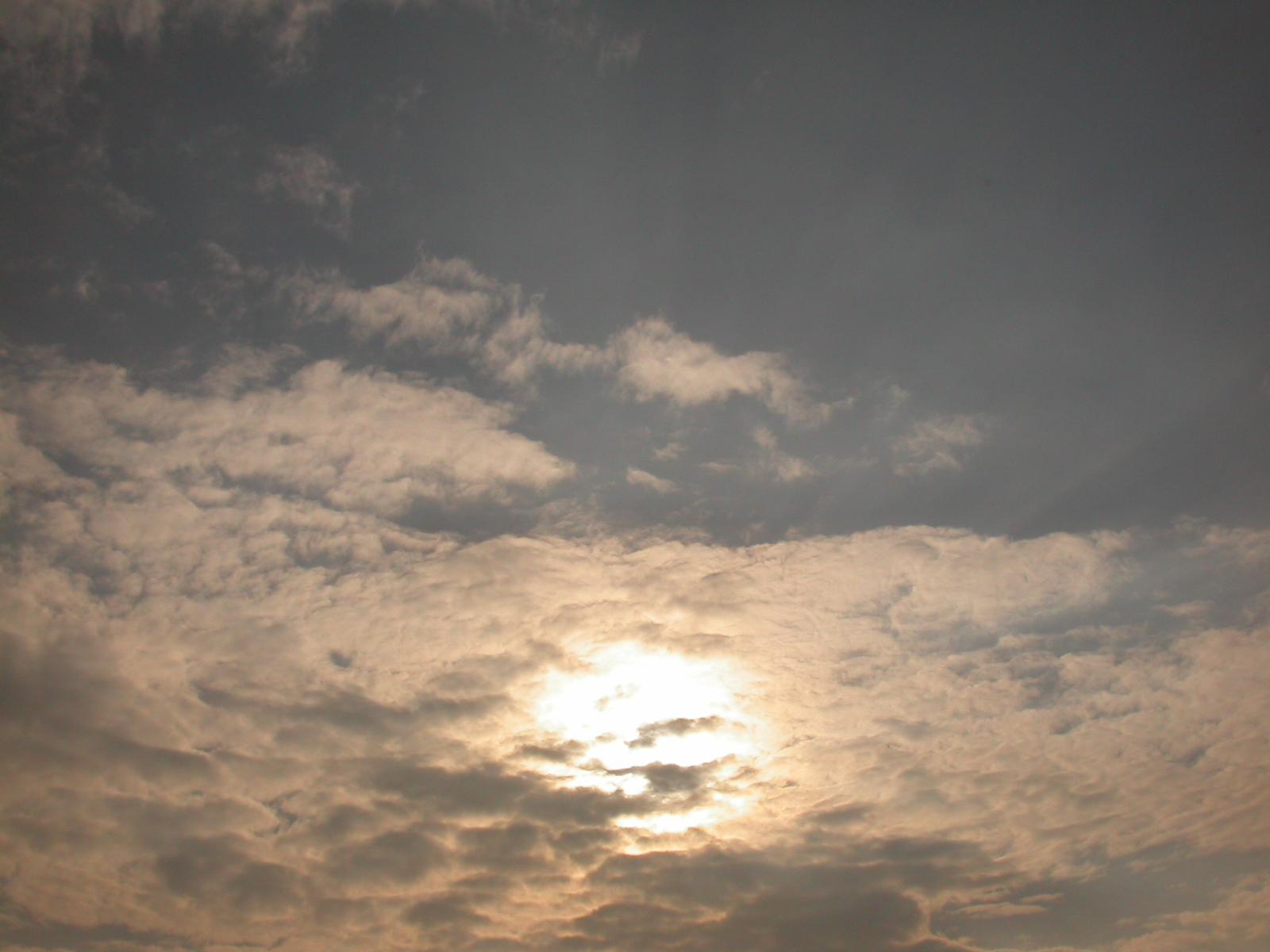 evening sky sun behind clouds eva