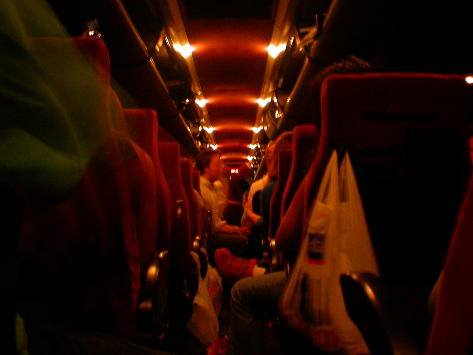 eva bus seats travling red dark lights passengers