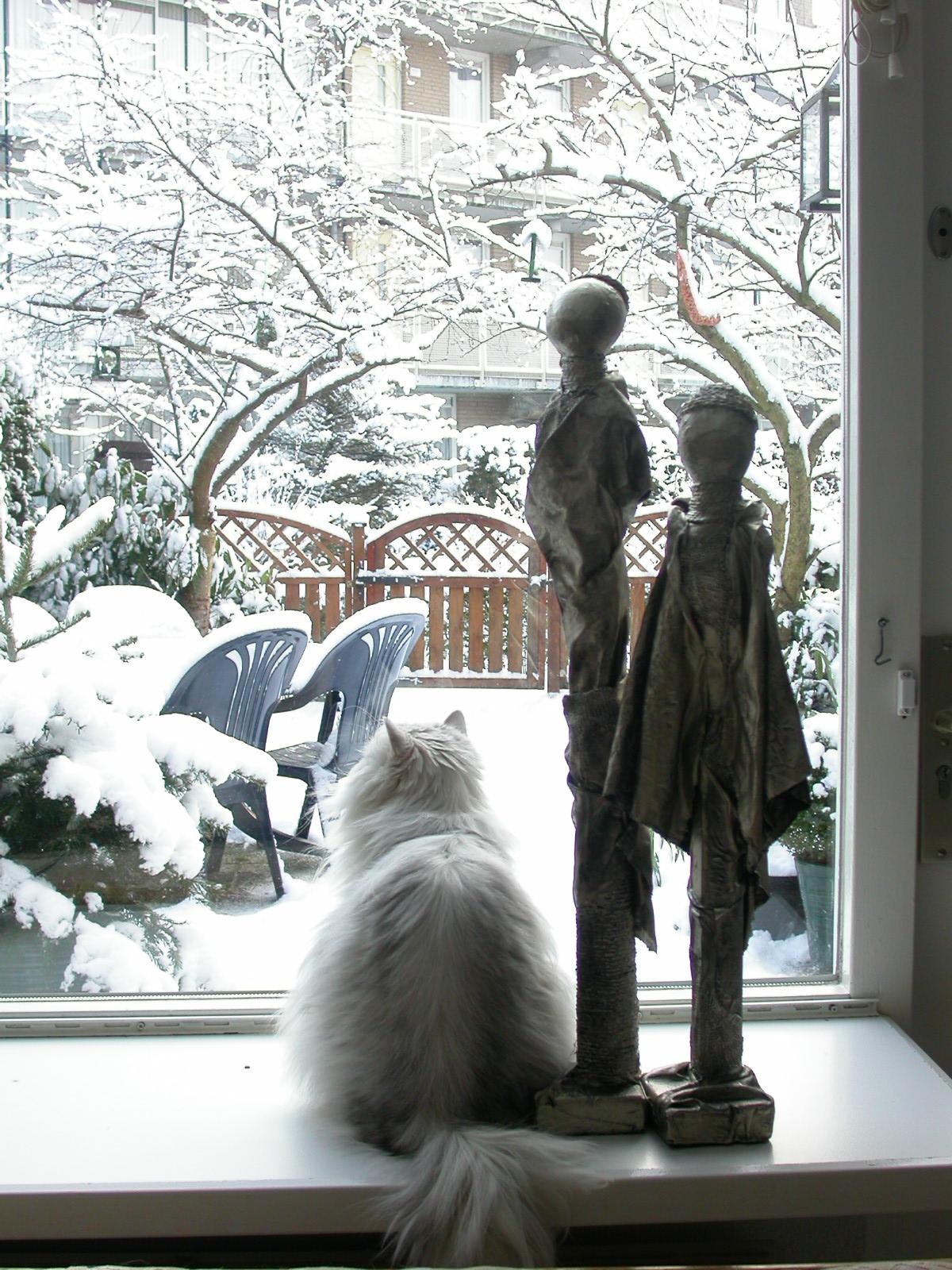 eva art sculptures winter cat staring out the window animals land human figures