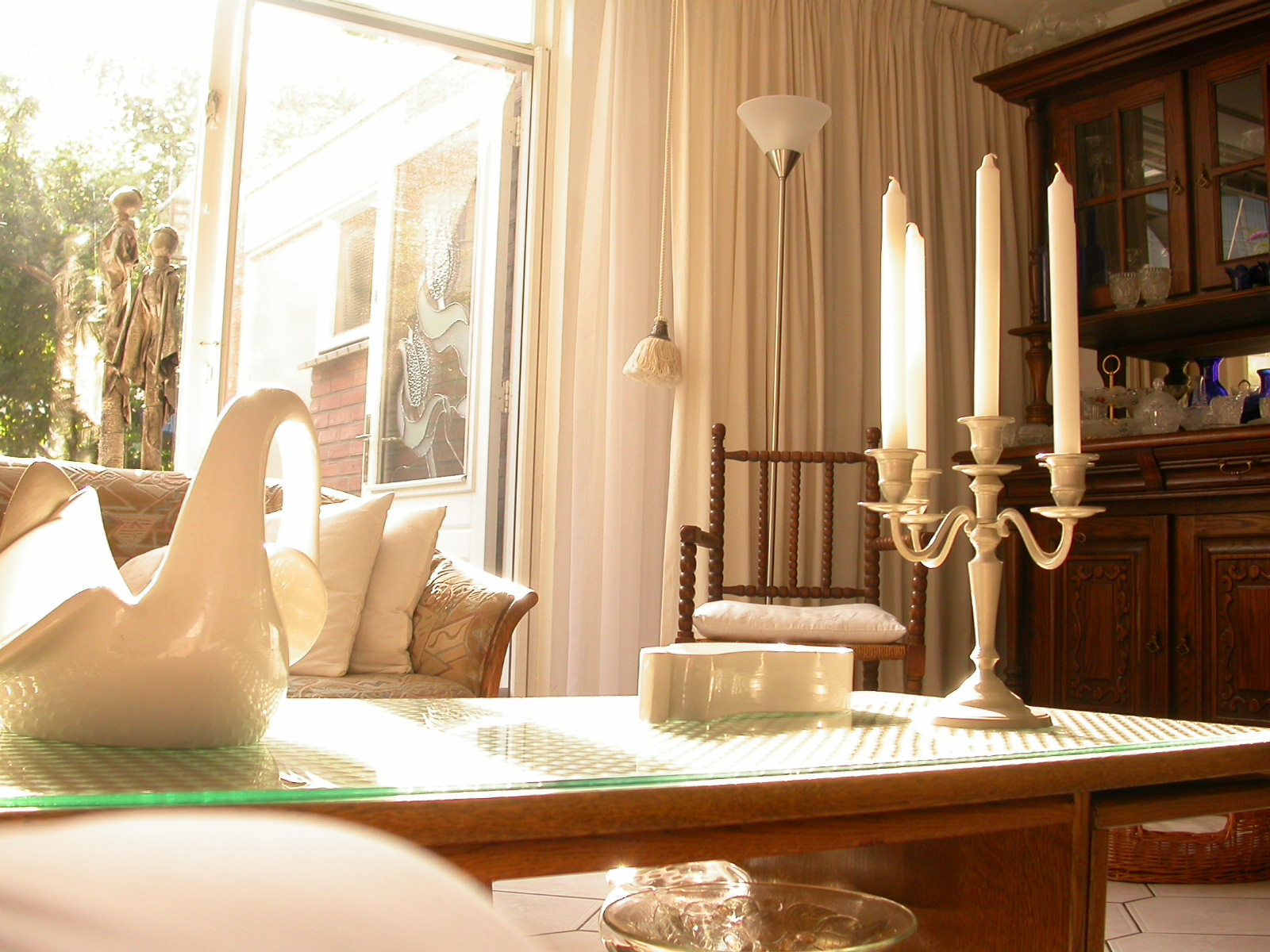 eva living room beautifully lit by sun warmth candles peace relaxation