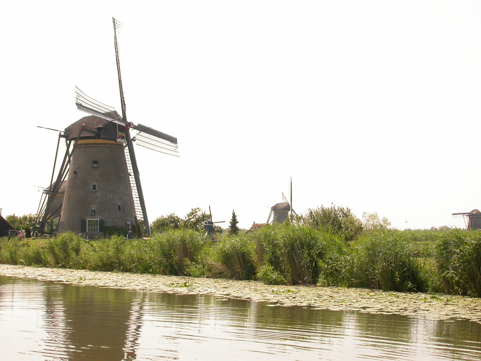 eva windmills mill windmill holland the netherlands shore waters edge