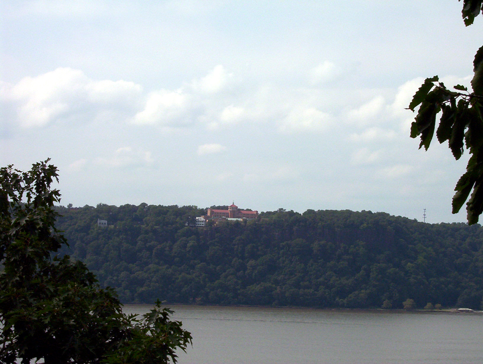 joelhacker mansion house on a hill overlooking a lake trees green royalty-free