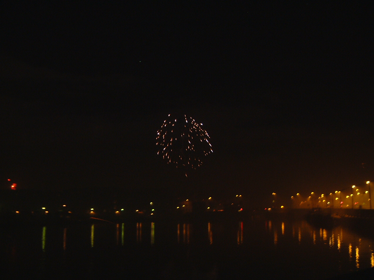 maartent fireworks above city blurry lake