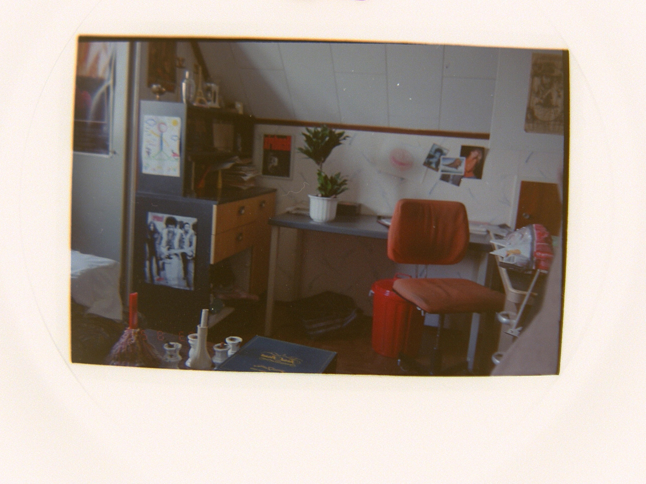 maartent bed room orange chair posters drawings photos desk