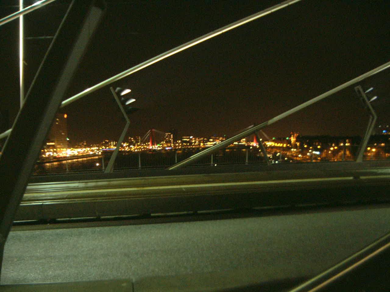 maartent bridge rotterdam zwaan nighttime night time dark car road driving skyline city royalty-free