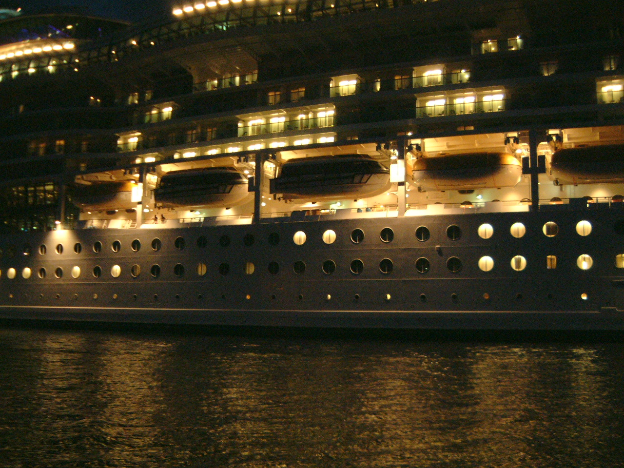 maartent ship ocean liner cruise boat lights nighttime portholes party