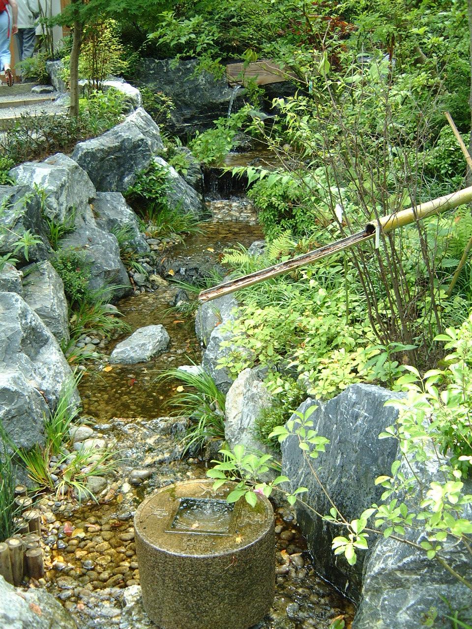 maartent asian japanese garden water bamboo pipe rocks pebbles stream