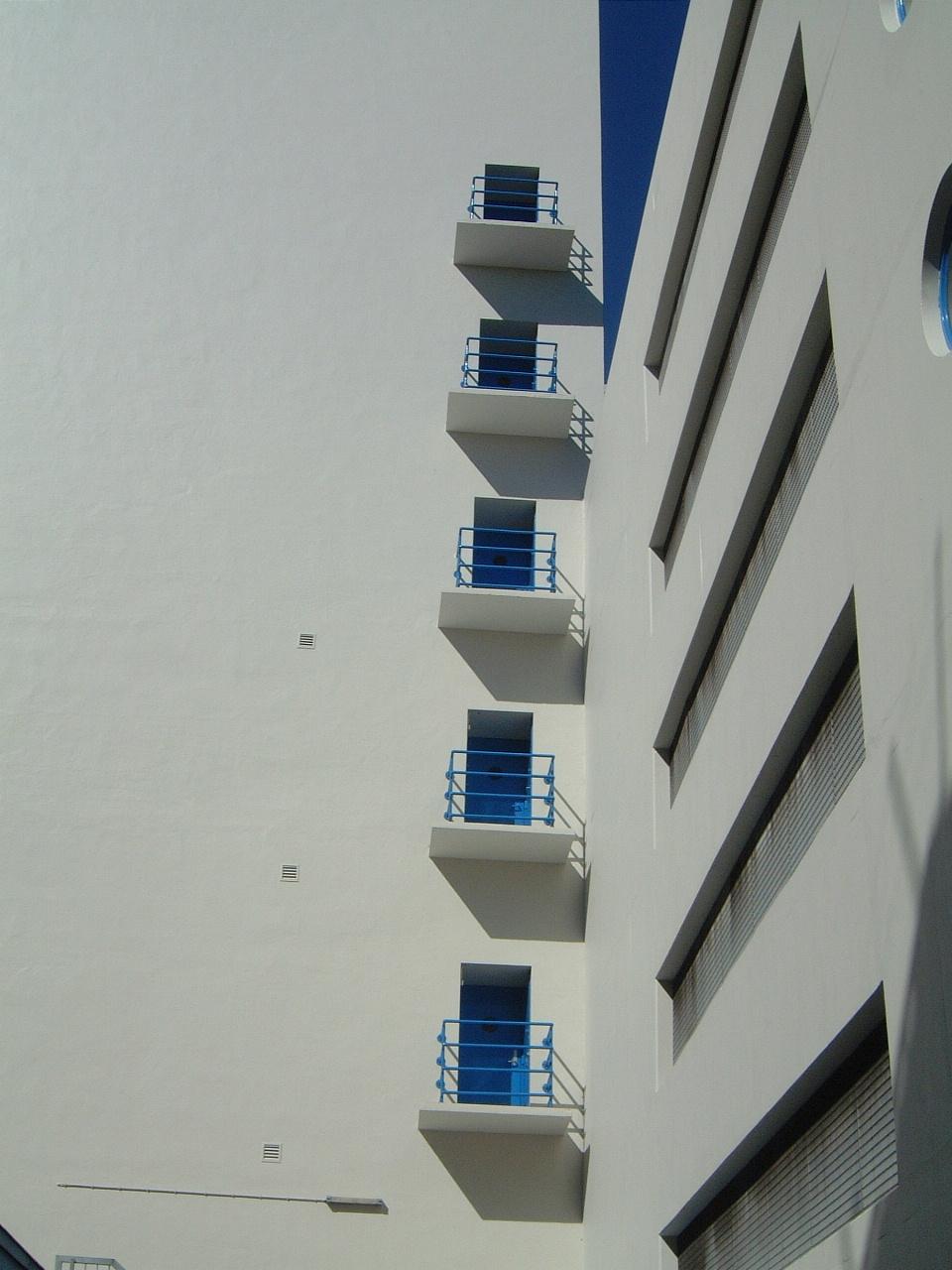white building balconies fences facade architecture maartent