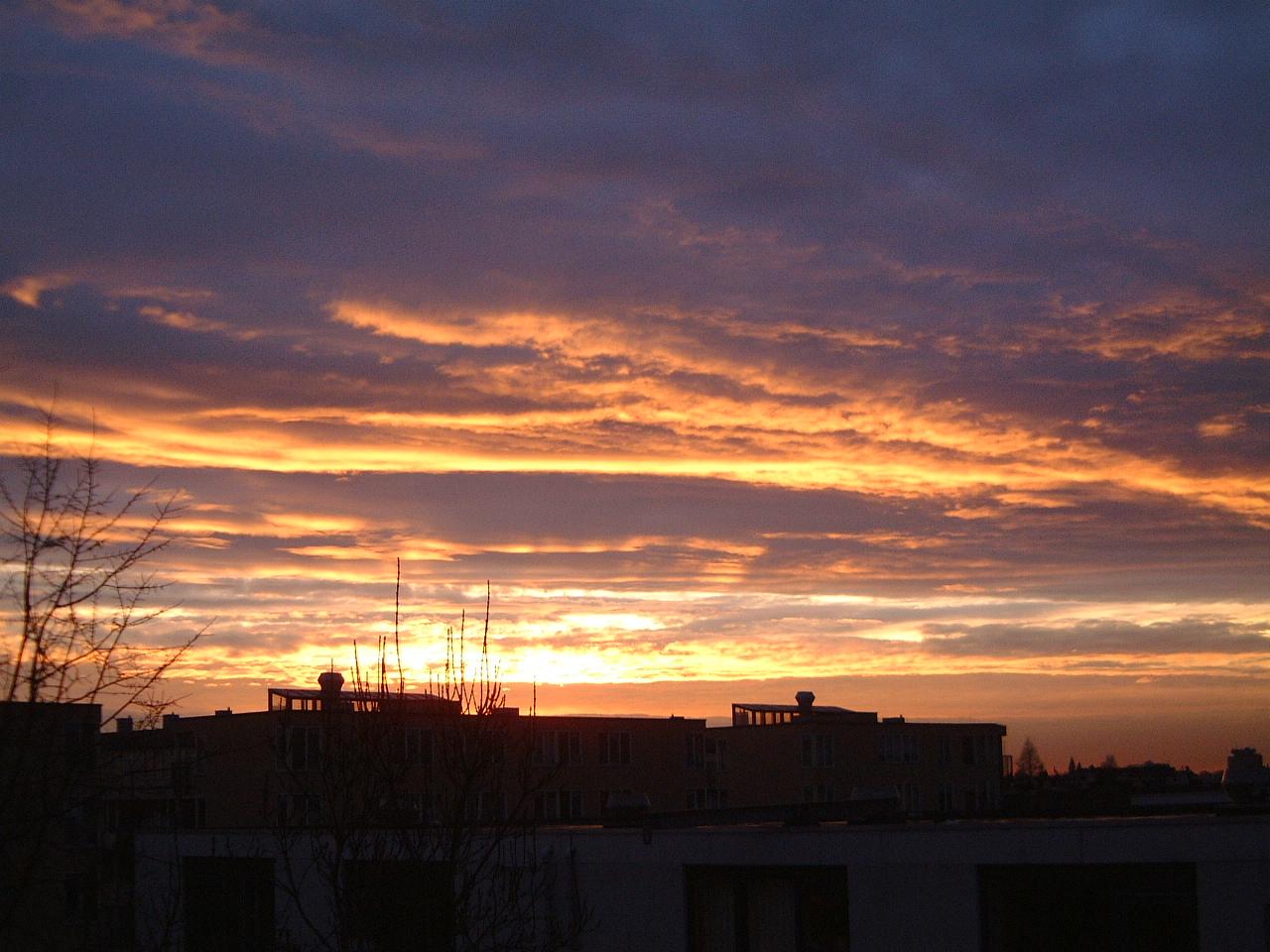 maartent sunset sunrise orange yellow blue silhouette houses