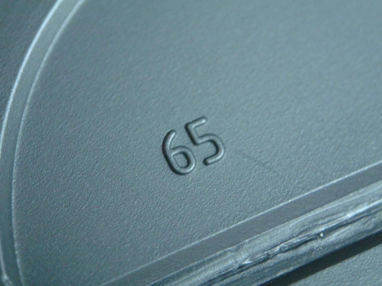 maartent 65 plastic number on black