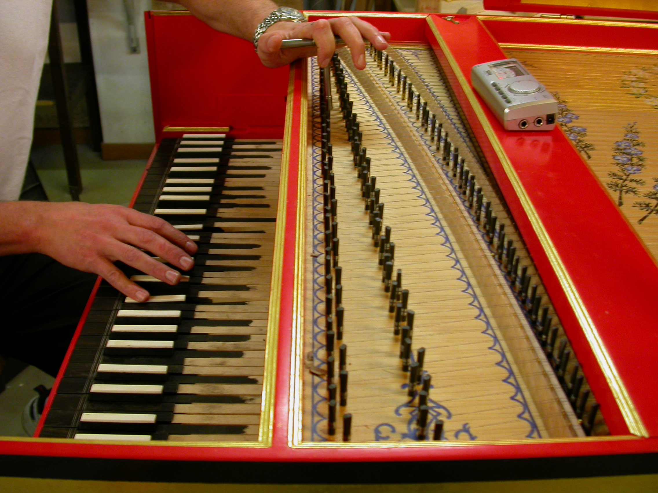 piano under construction hand playing music snares paul red