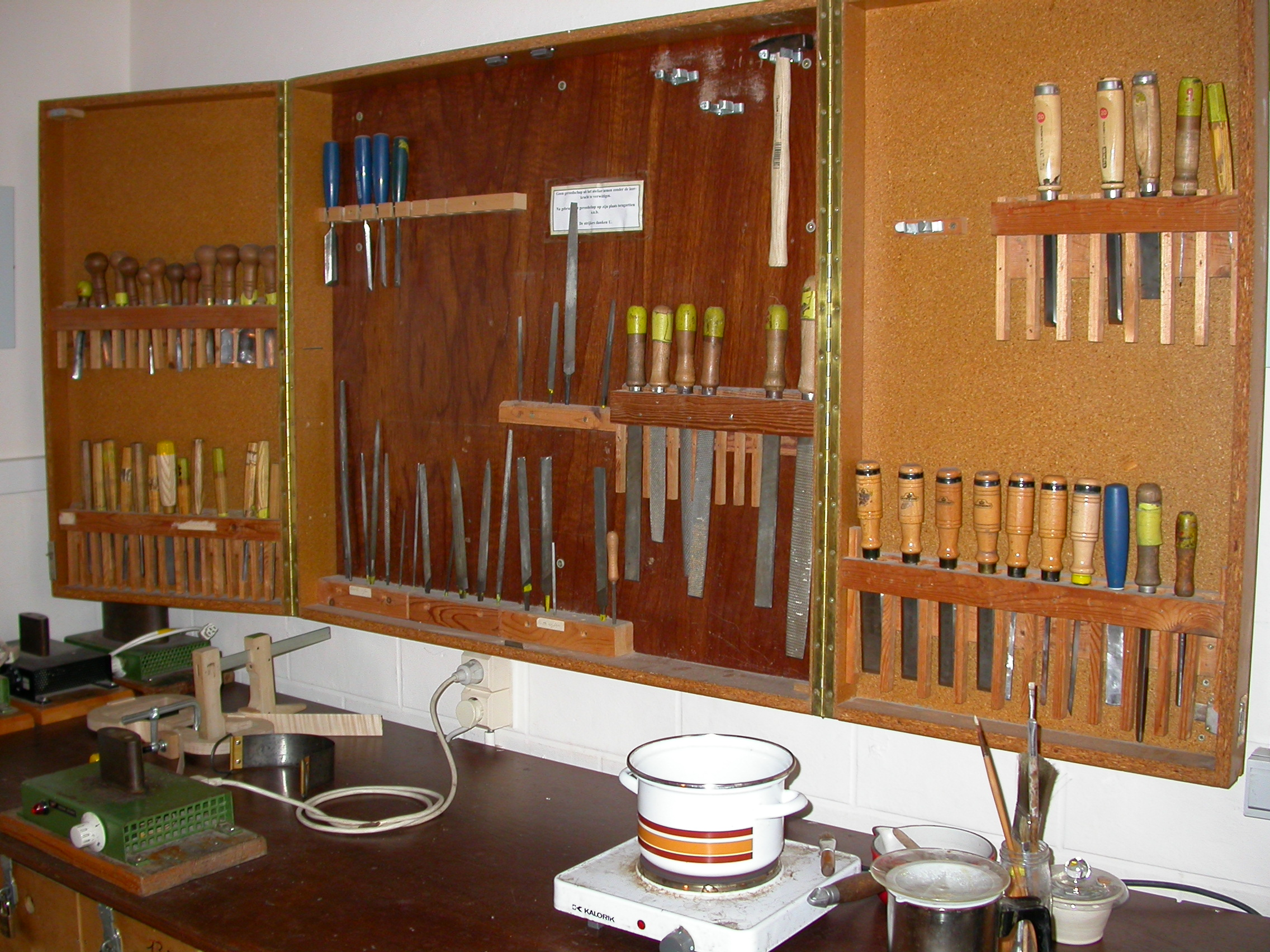tools on a wall wood working work bench trade paul