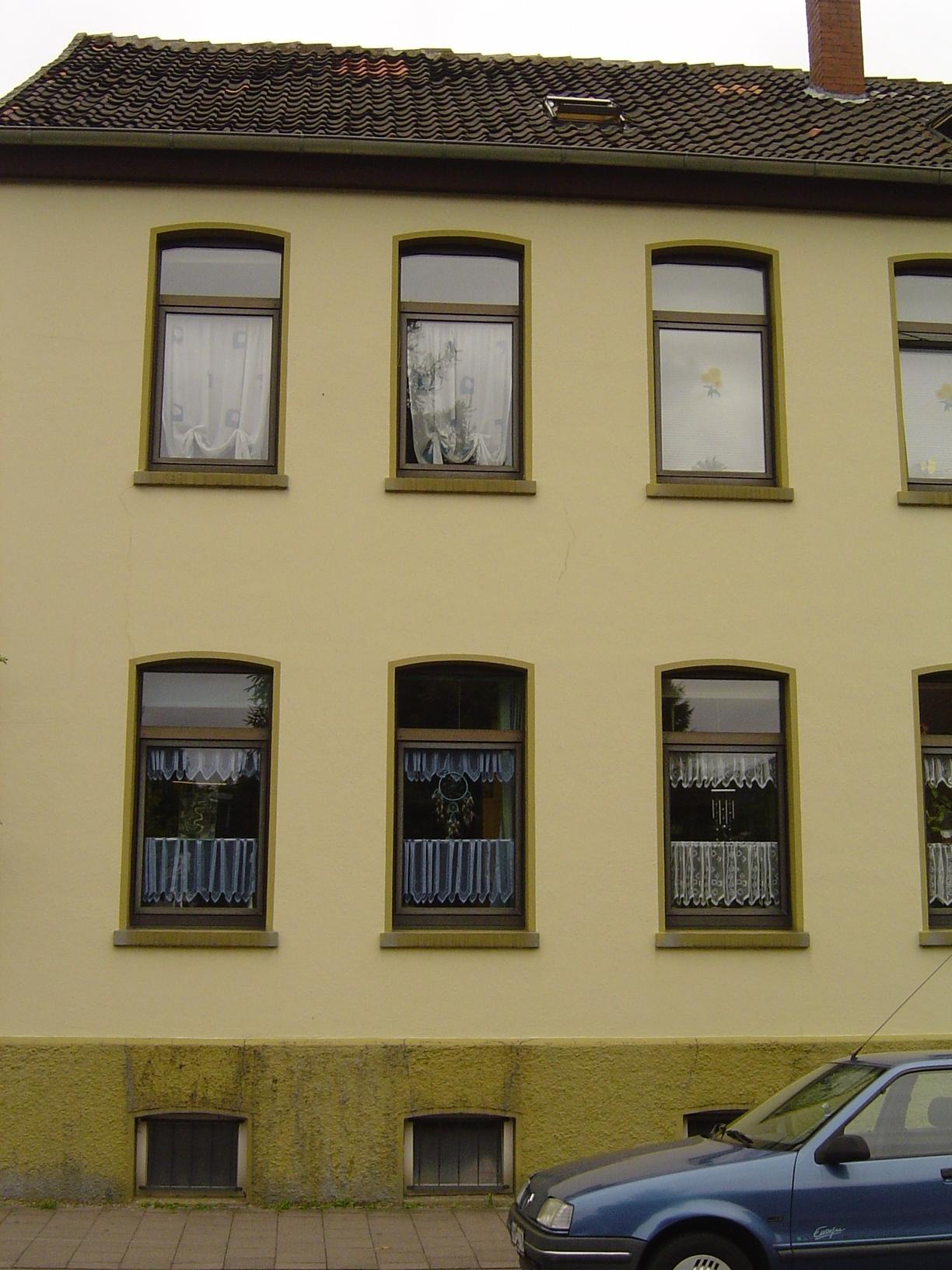 rigoletto house yellow wall tall windows