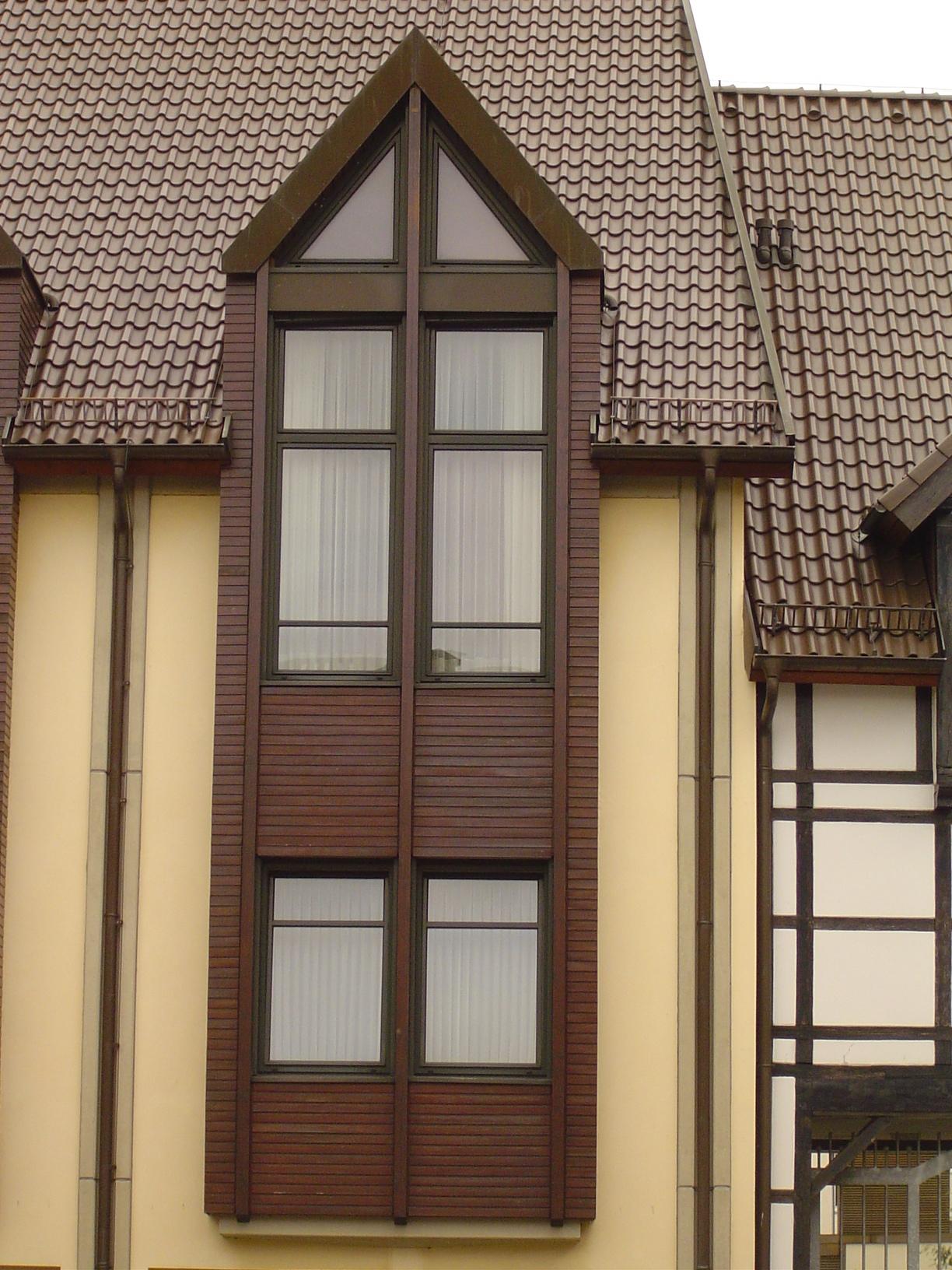 rigoletto tudor house brown high windows side mansion