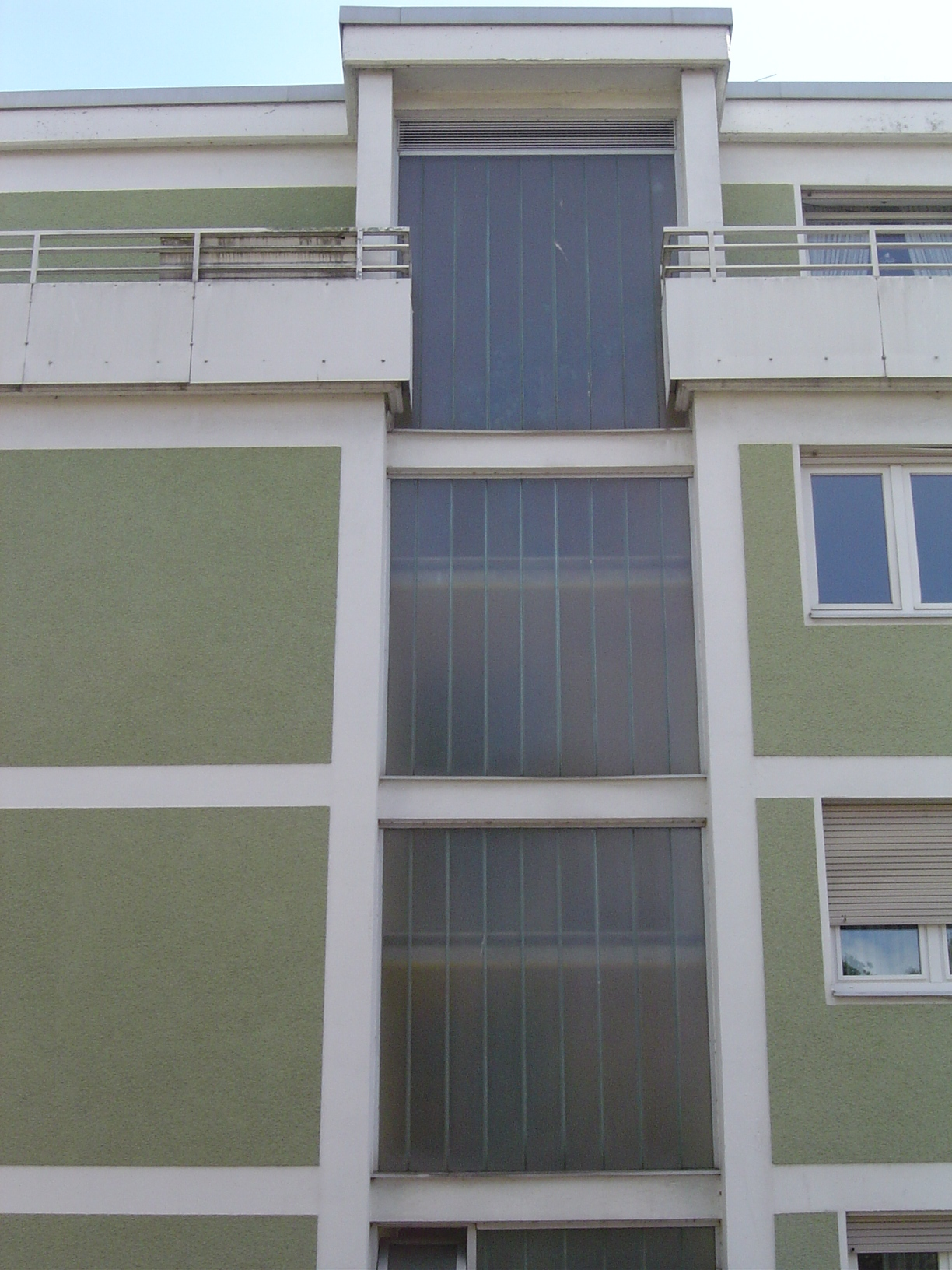 rigoletto building block of flats windows green white windows