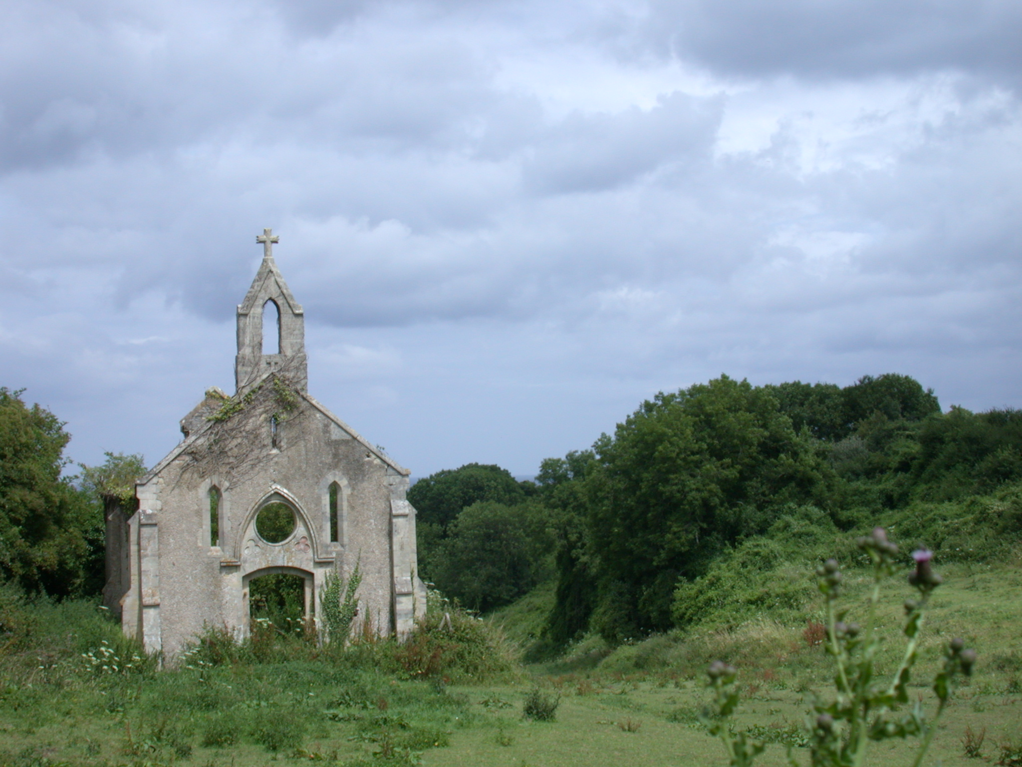 abandoned church in a meadow field white