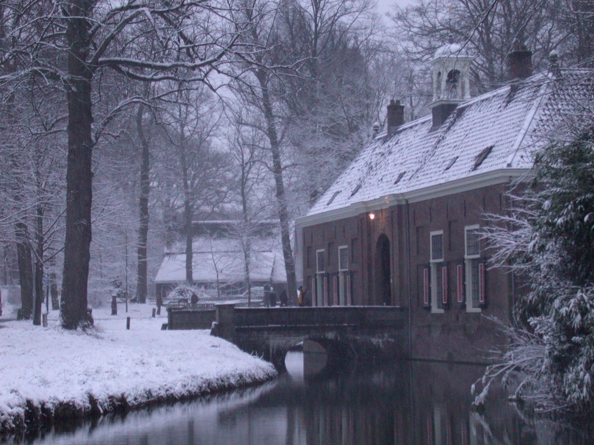 castle in snow drawbridge bridge water