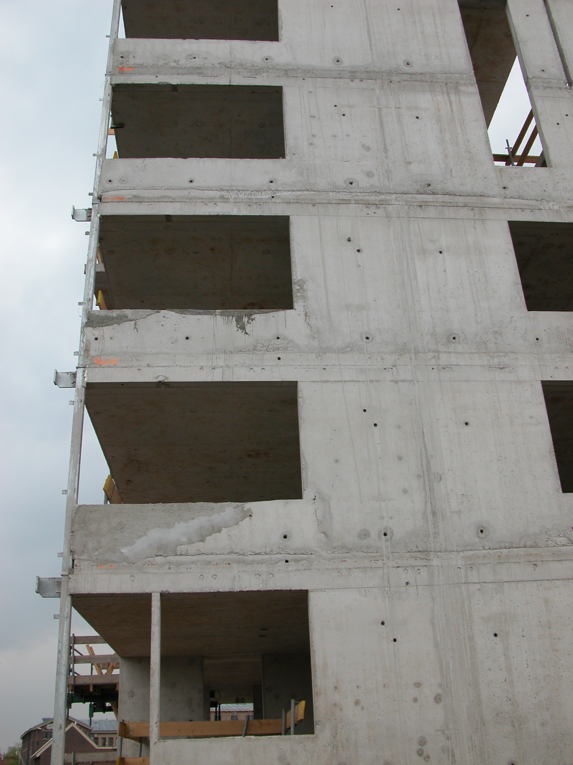 tower block of flats building under construction concrete solid grey gray