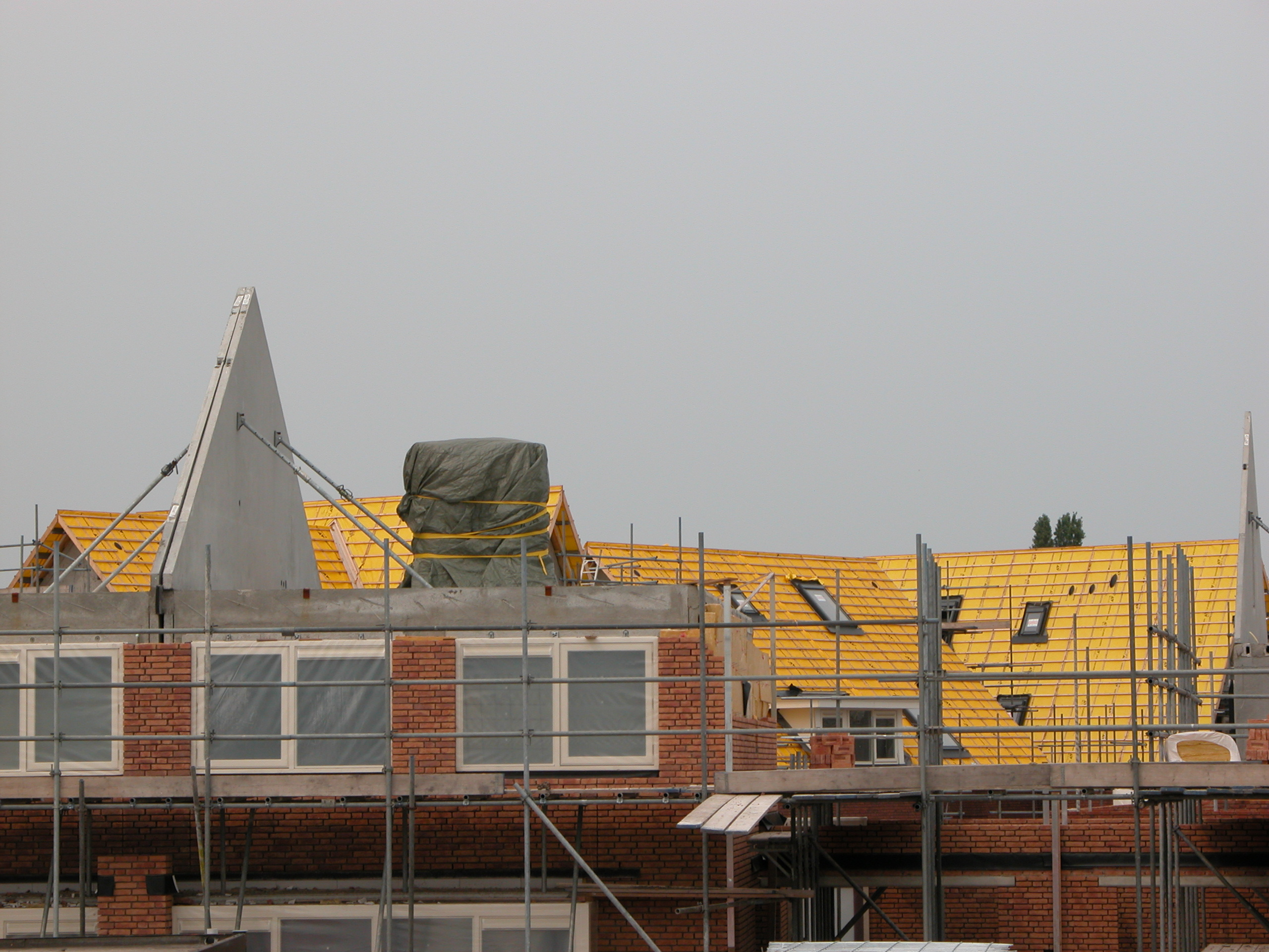roof rooftop yellow bricks scaffolding building construction site
