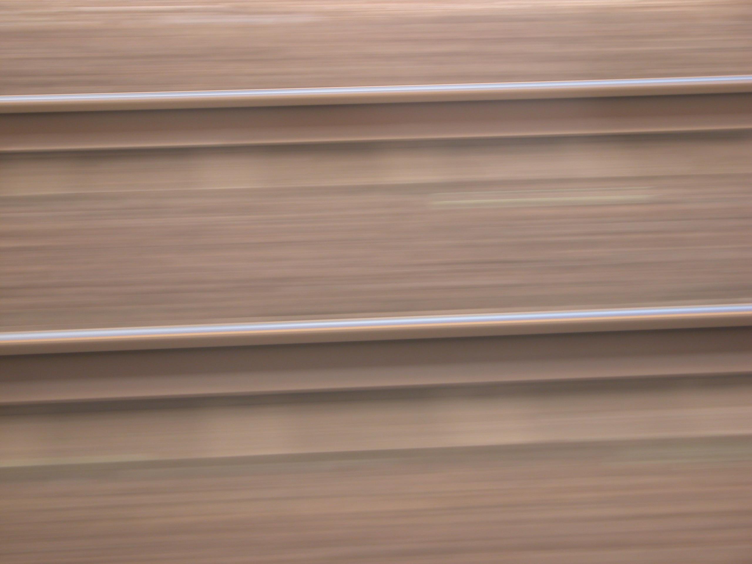 blur whizzing by traintracks rail rails speed fast blazing