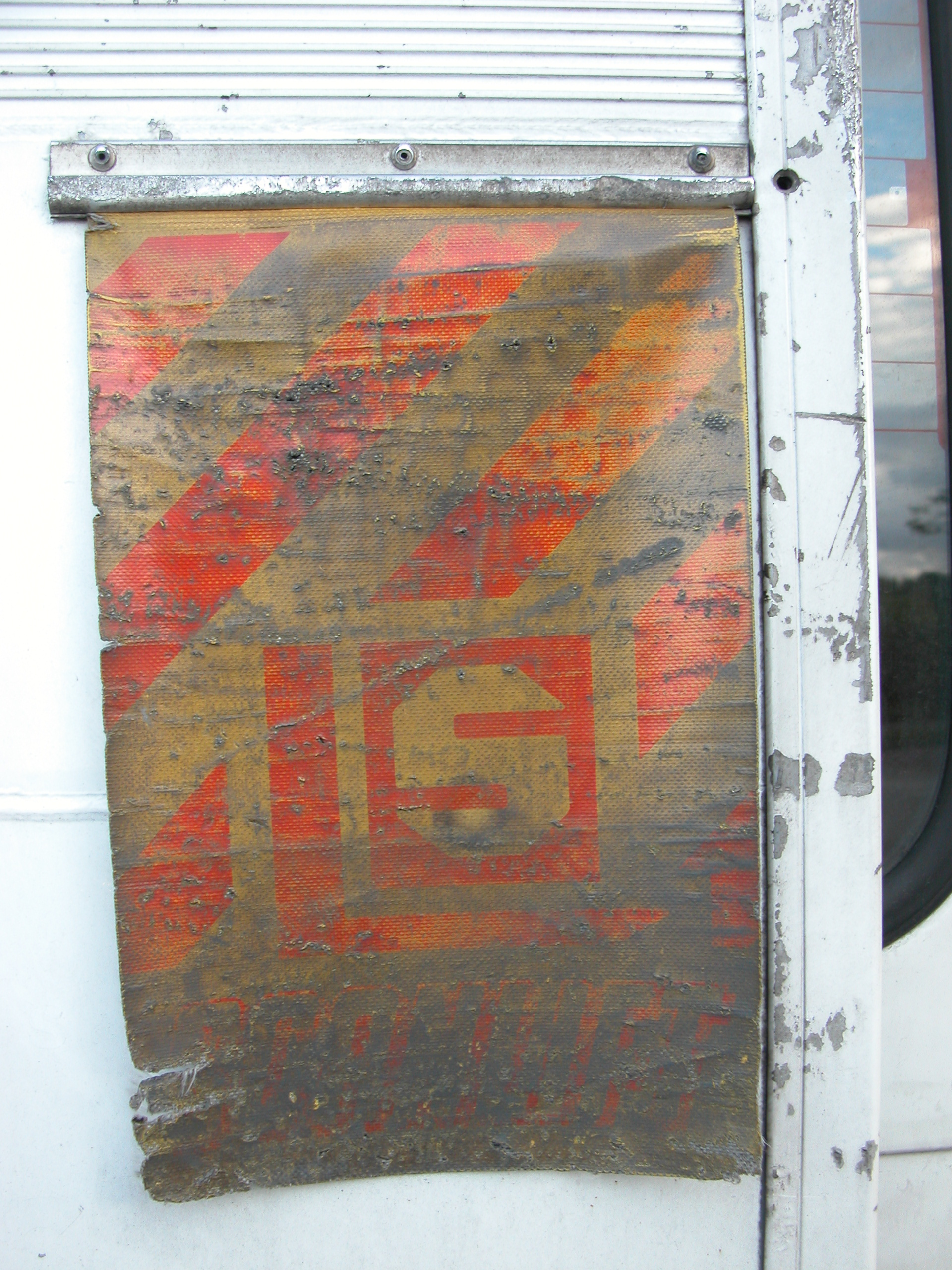 plastic warning flag on the back of a truck red and yellow