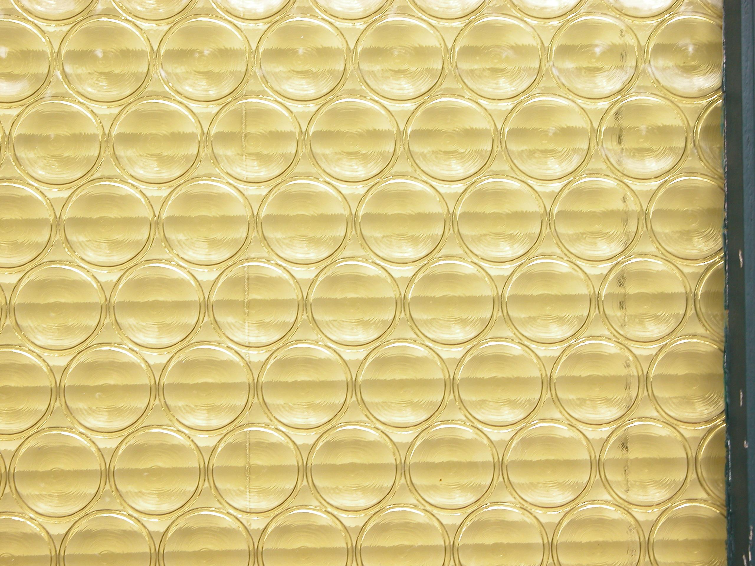 yellow glase pane of a door circles