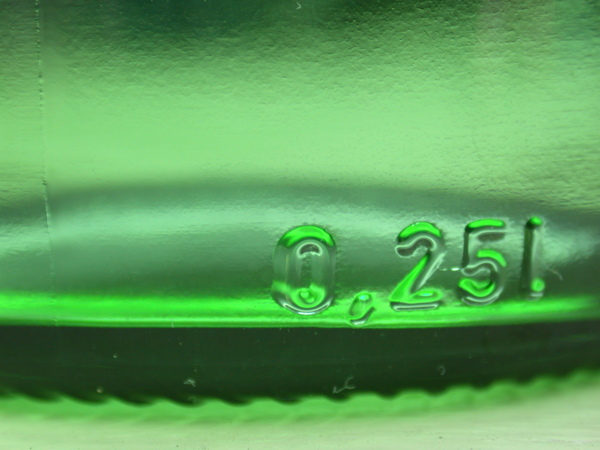 green underside of a bottle glass