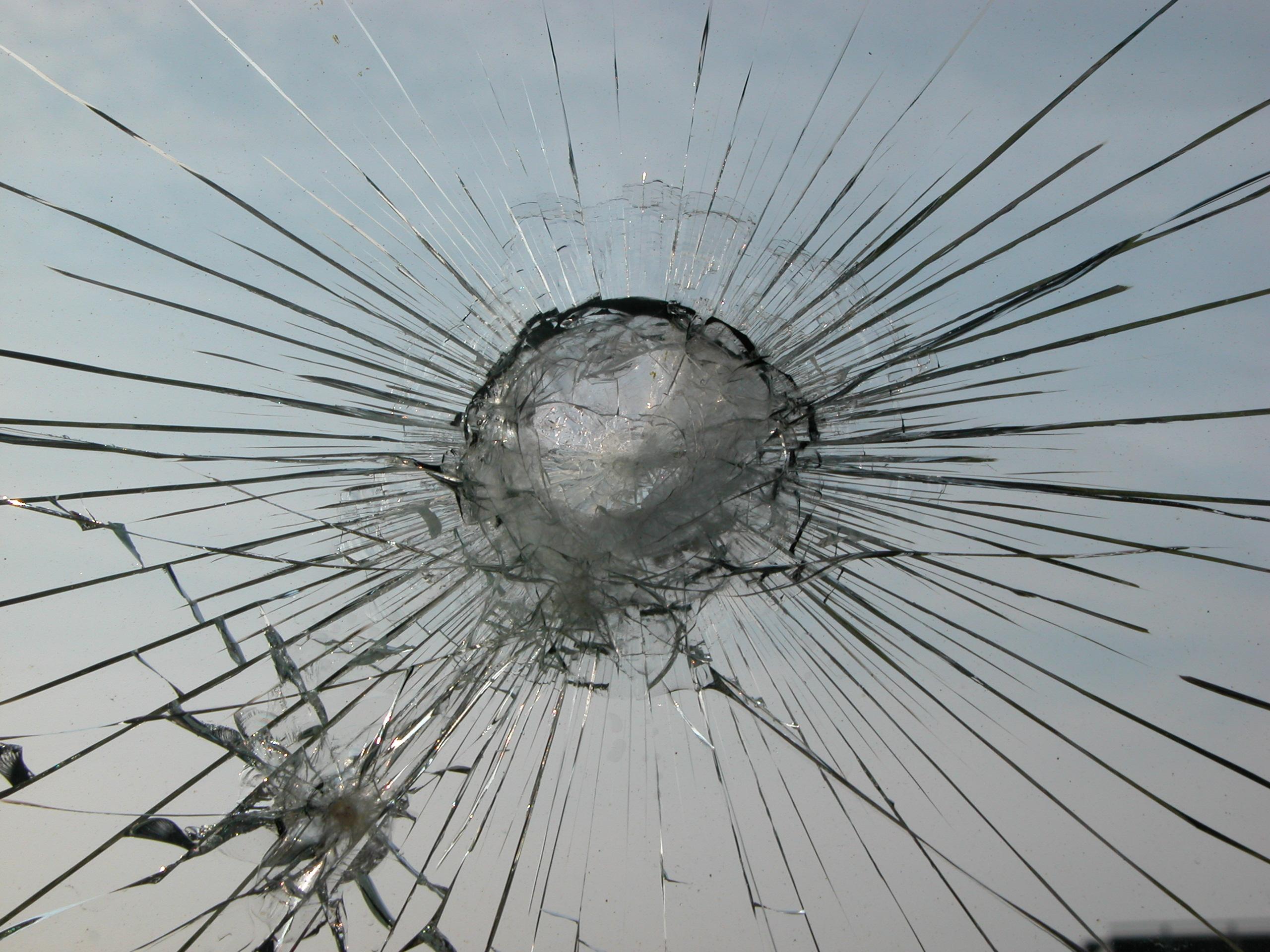 crack splintered glass window car windshield