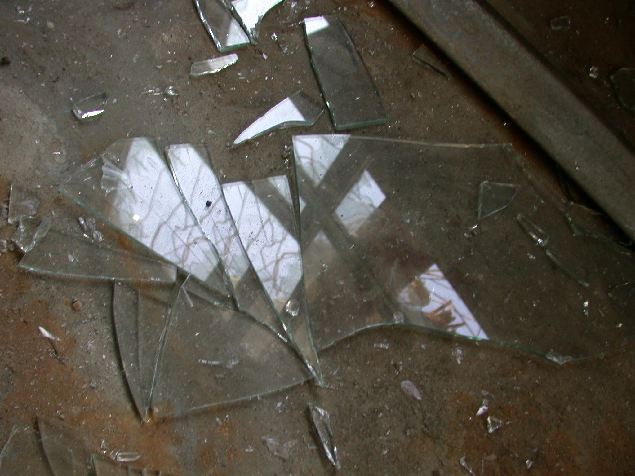 broken shards of glass on floor smashed fragments